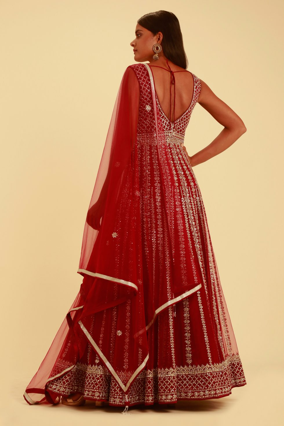 Magenta red anarkali gown set with matching dupatta and intricate silver details