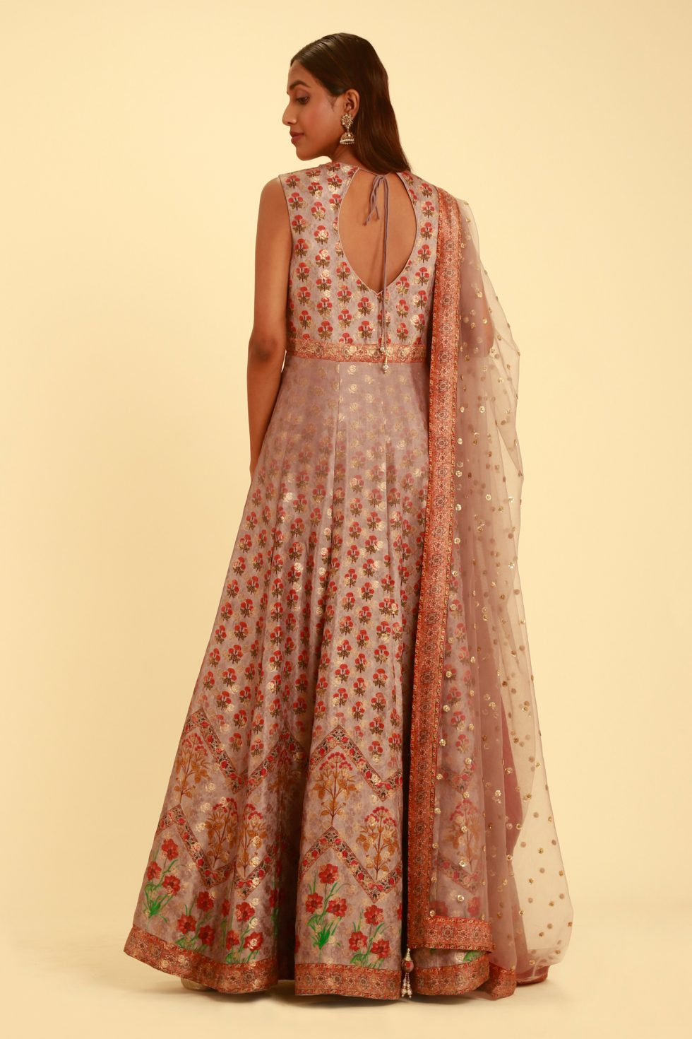 Mauve purple printed banarasi anarkali gown set with gold and silver details and matching dupatta