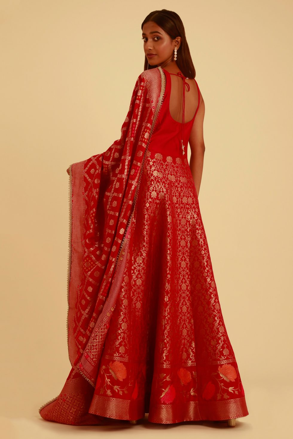 Red banarasi anarkali gown set with a matching dupatta and gold details