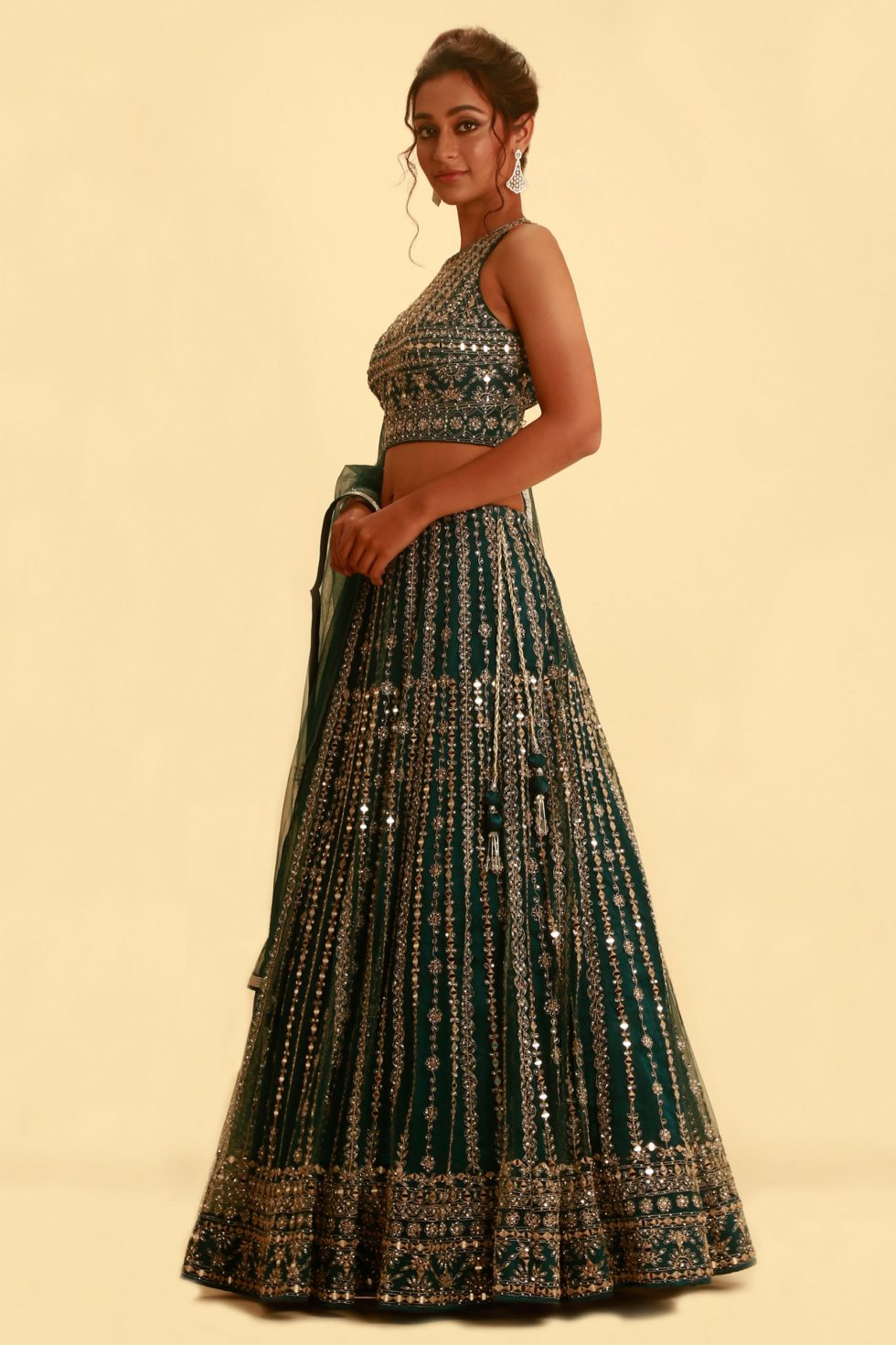 Emerald green lehenga set with silver embroidery and cutout blouse