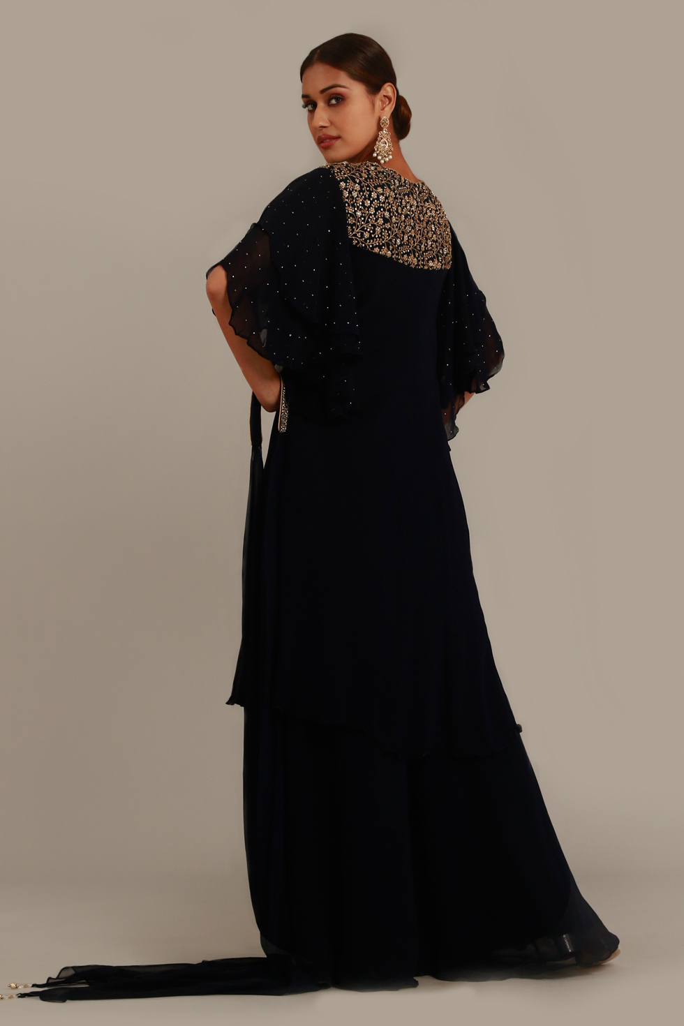 Raven black long top with palazzo pants, tiered ruffled sleeves, gold embellishments on the yoke and matching necklace dupatta
