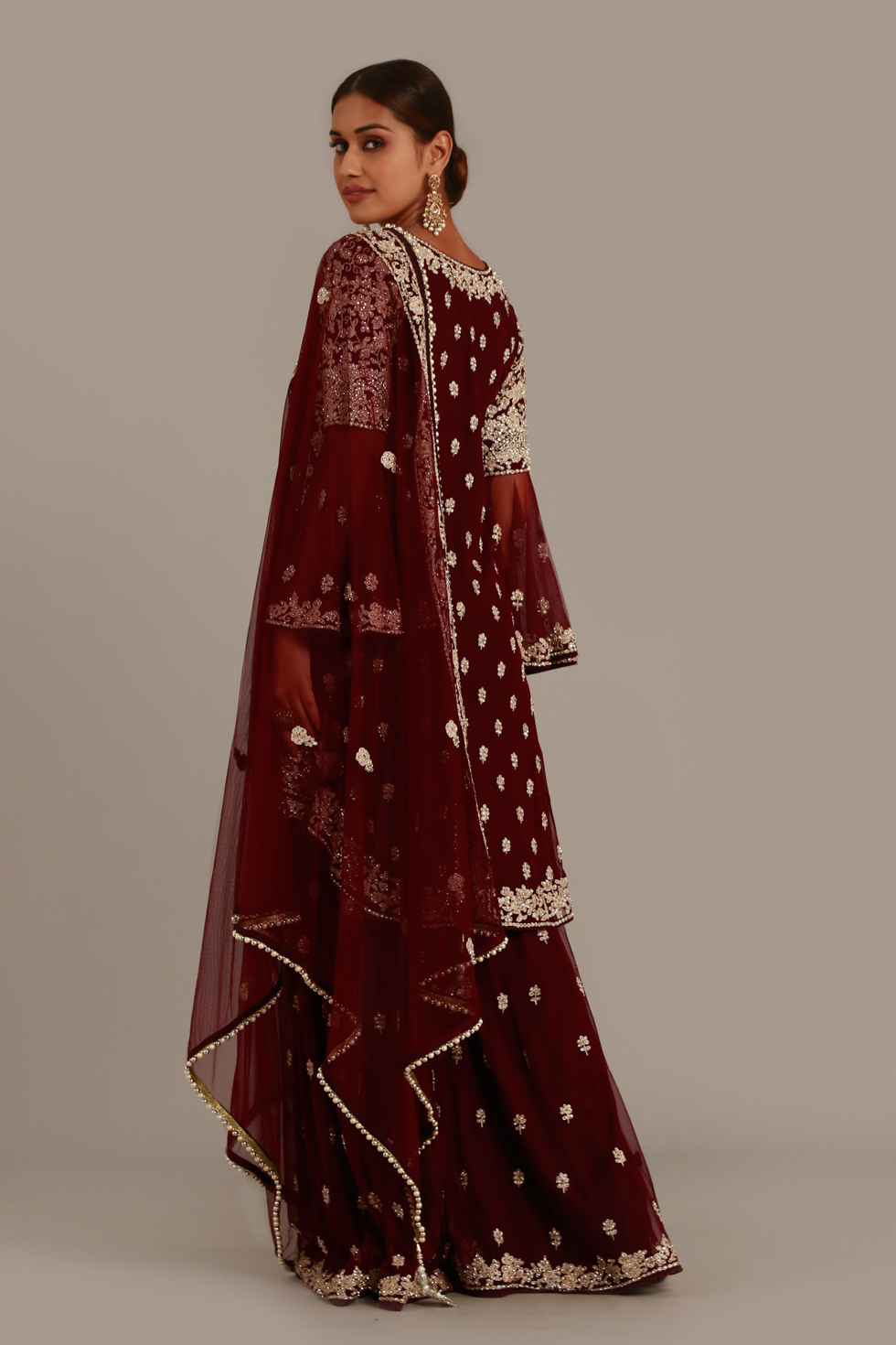 Wine burgundy layered palazzo set with silver classic embroidery, bell sleeves, high low hem jacket and matching dupatta