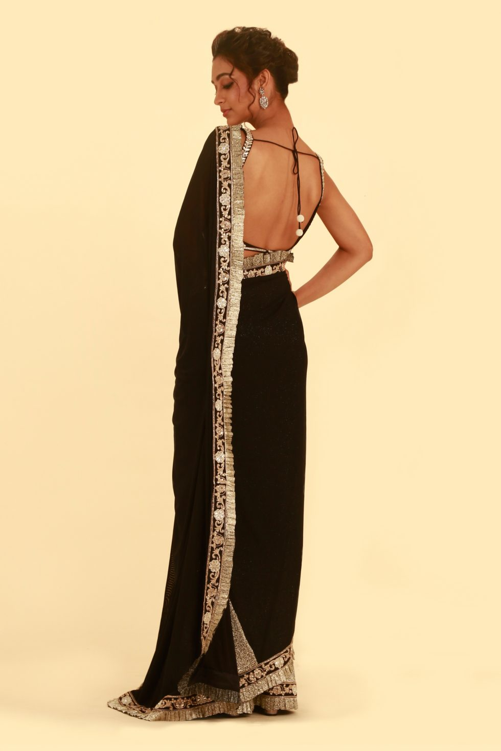 Black and silver classic saree with silver frill detail and matching embroidered corset choli