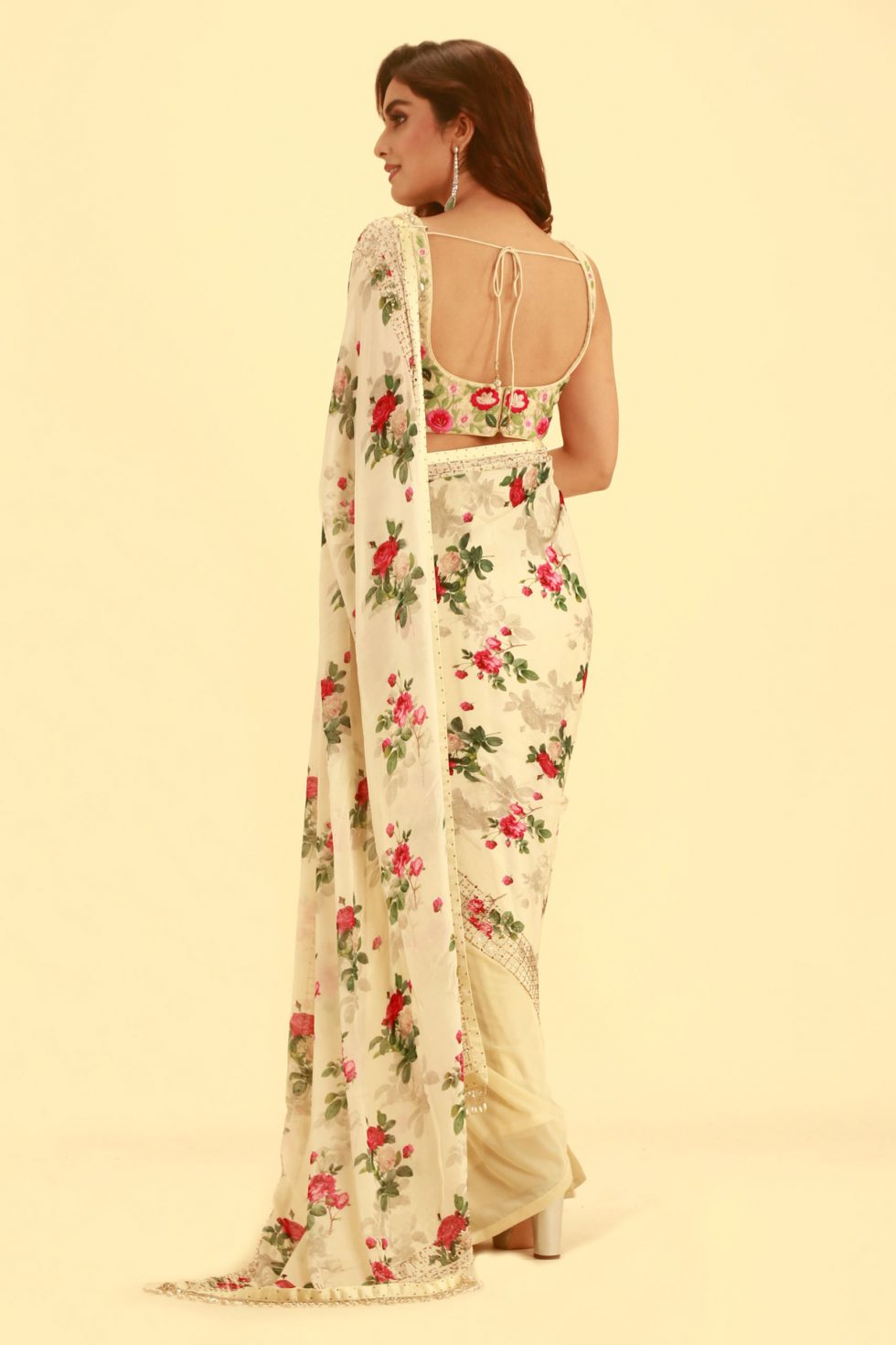 Cream saree with printed pallu and embroidered blouse with floral motifs
