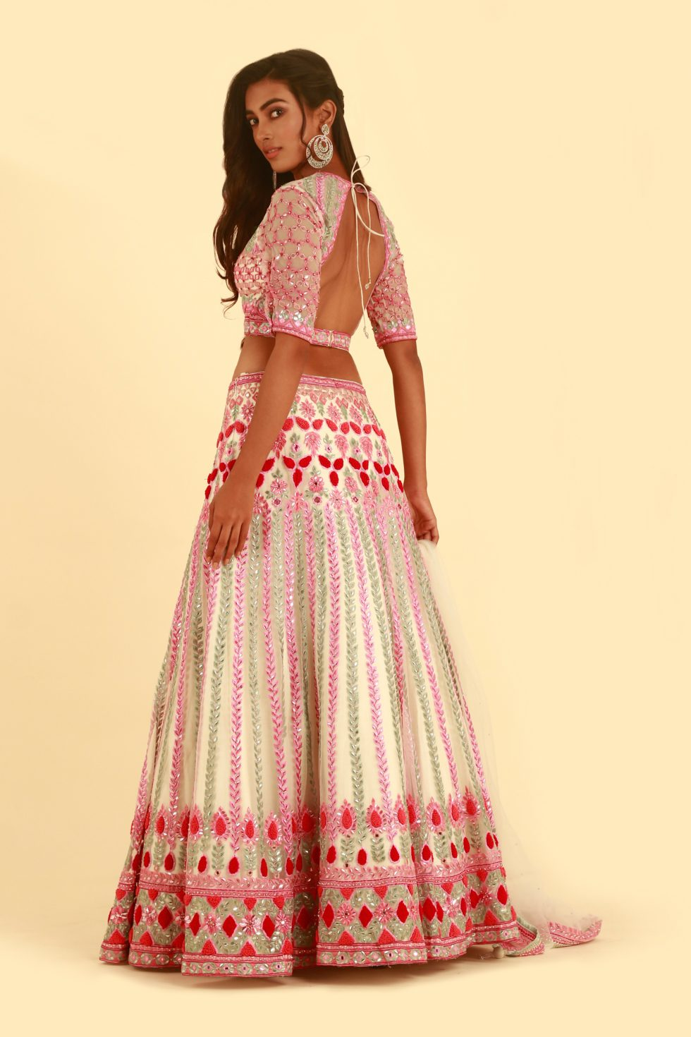White lehenga set with contrast embroidered and matching dupatta with bead work