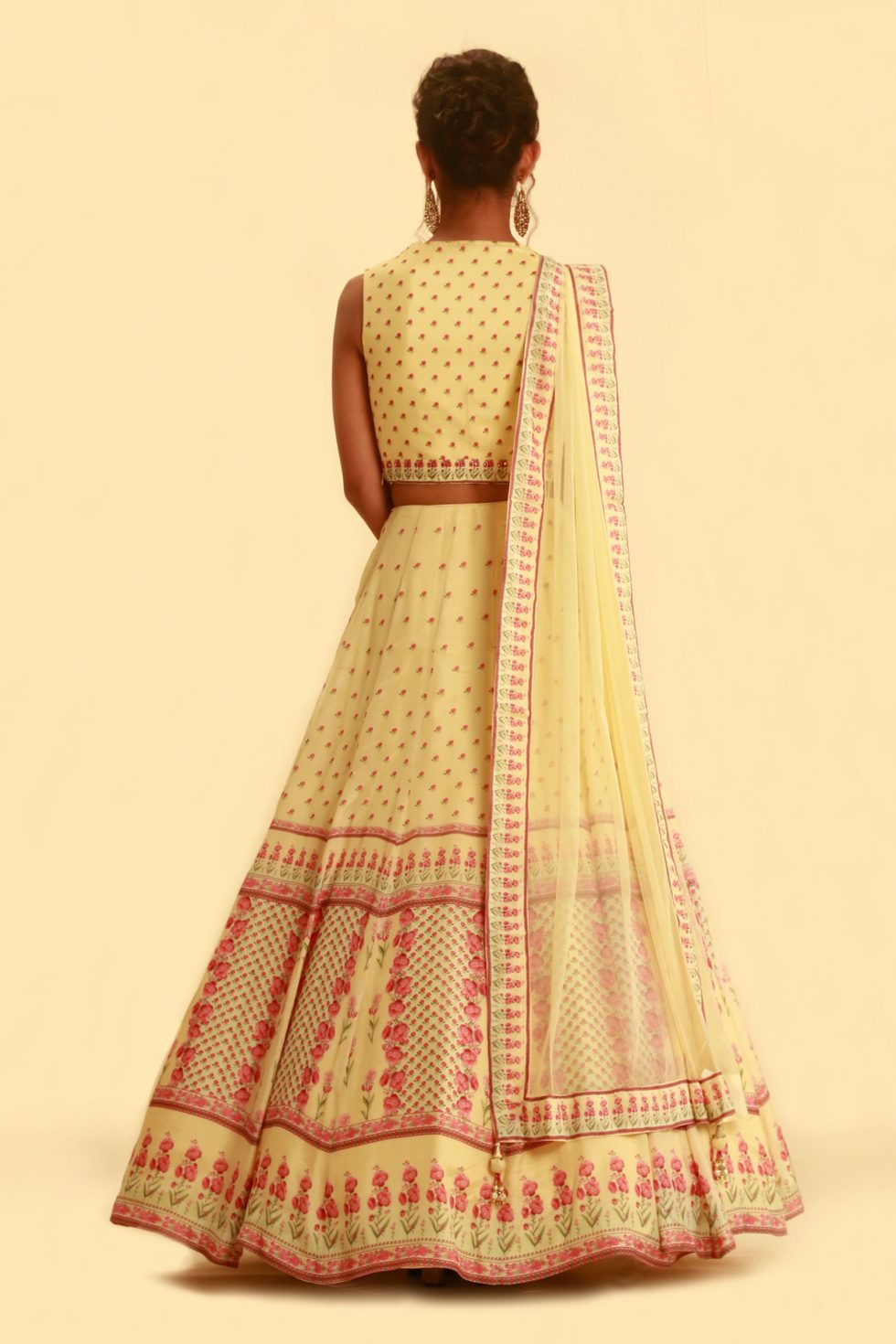 Lemon yellow printed lehenga set with matching dupatta and gold highlights