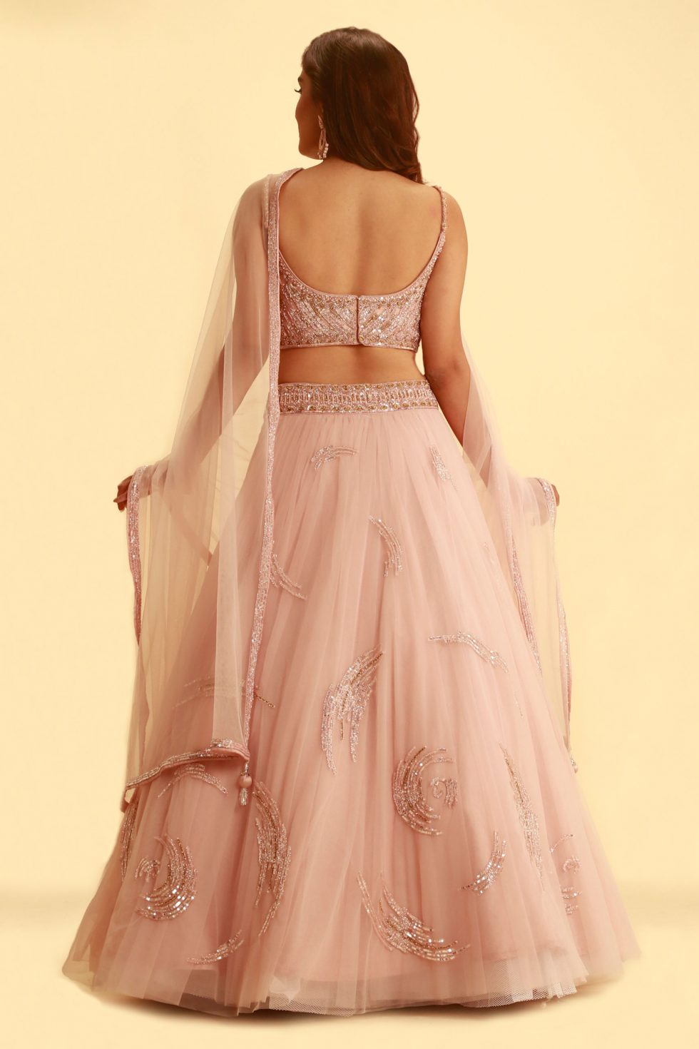 Petal pink tulle lehenga set with self embroidery and matching net dupatta