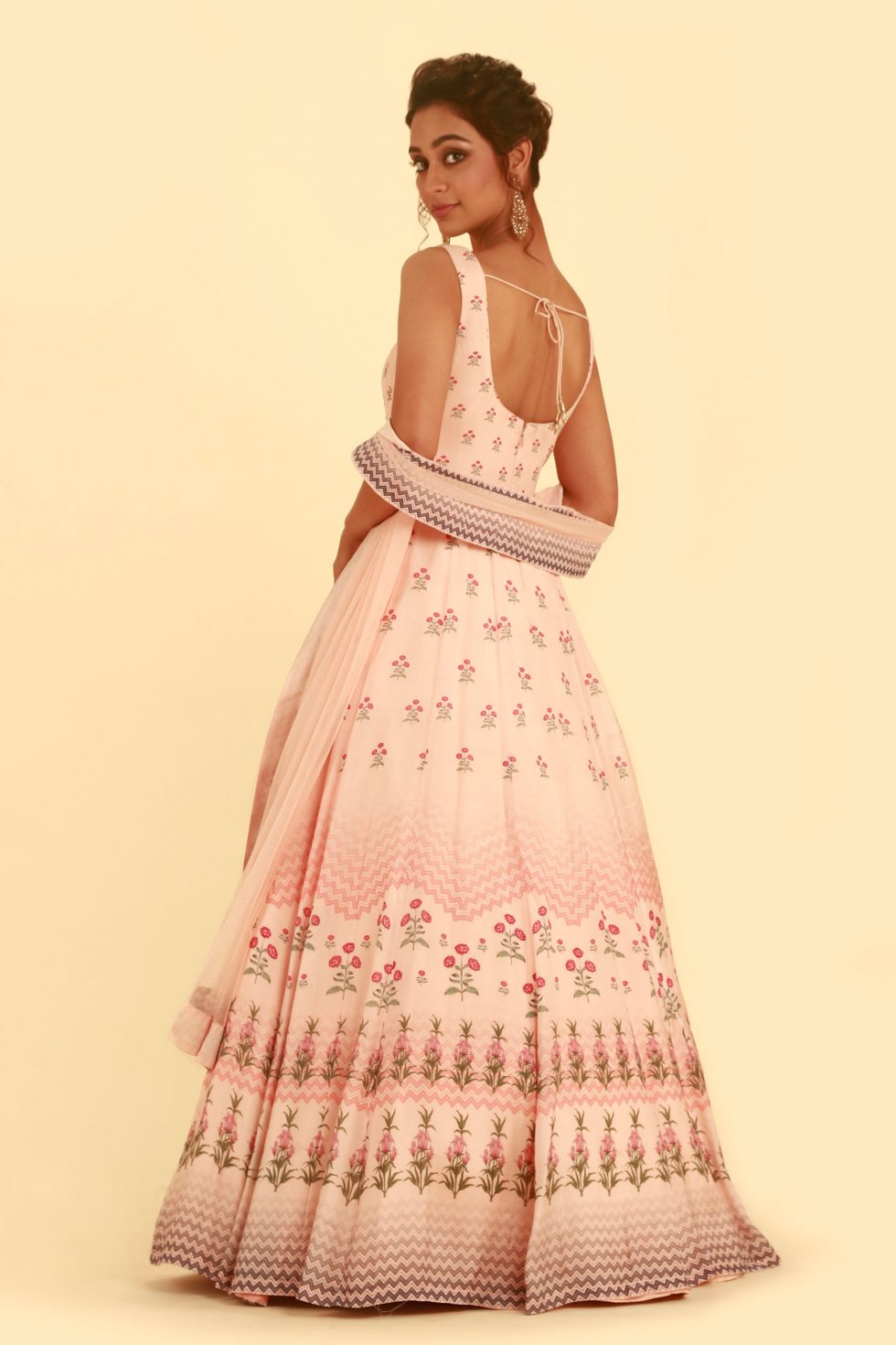Blush pink printed Anarkali gown set with matching dupatta and gold embellishments