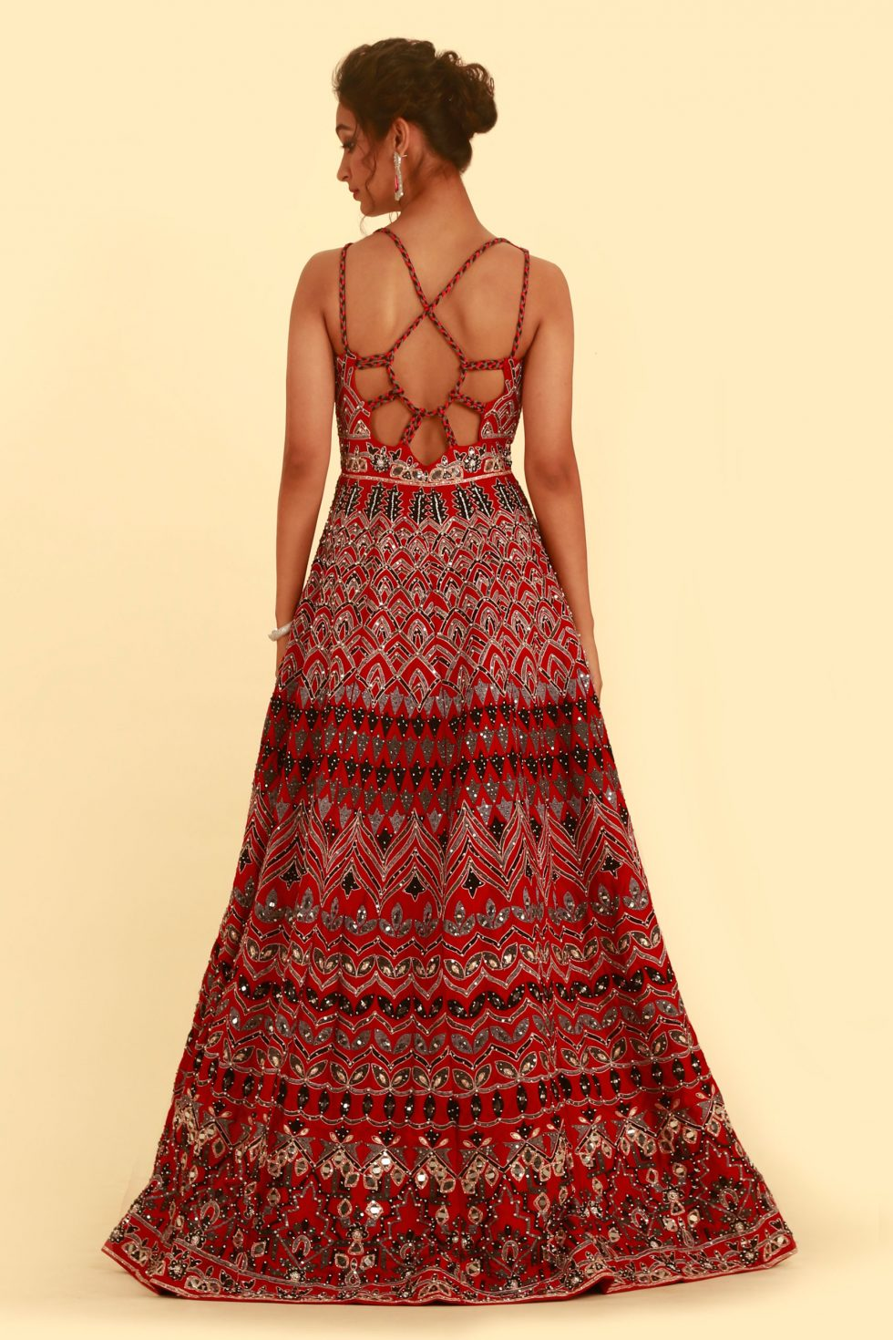 Fiery red gown set with contrast coloured embroidery, silver details and braided and cut out back details