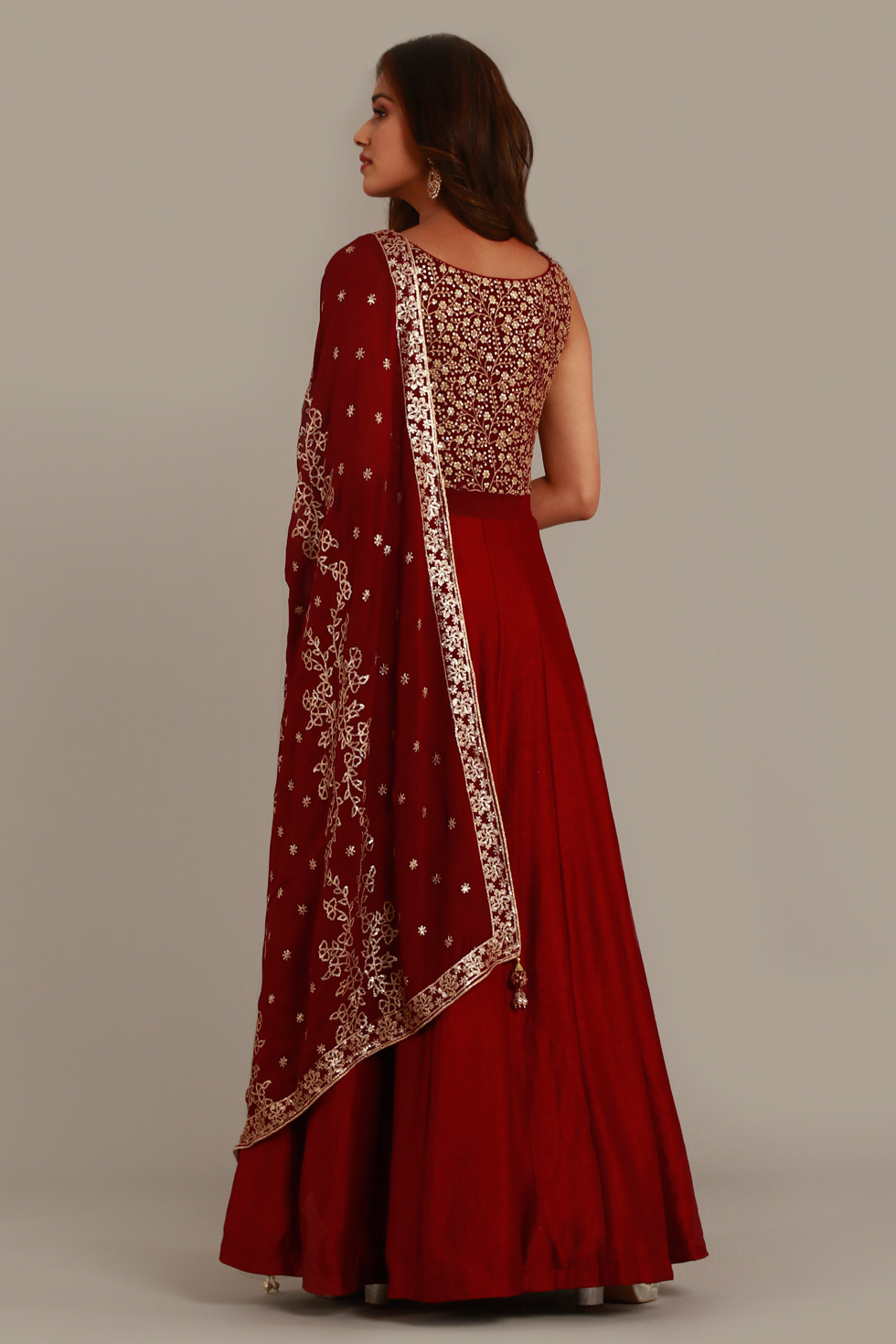Maroon red Anarkali gown set with matching dupatta and gold embellishments