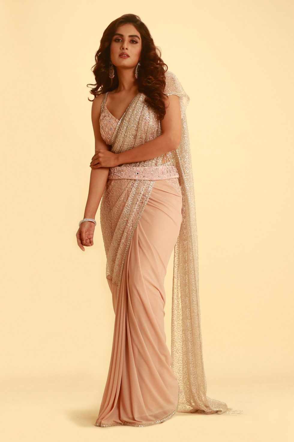 Baby pink saree with beaded pallu and matching cut out blouse with tassels