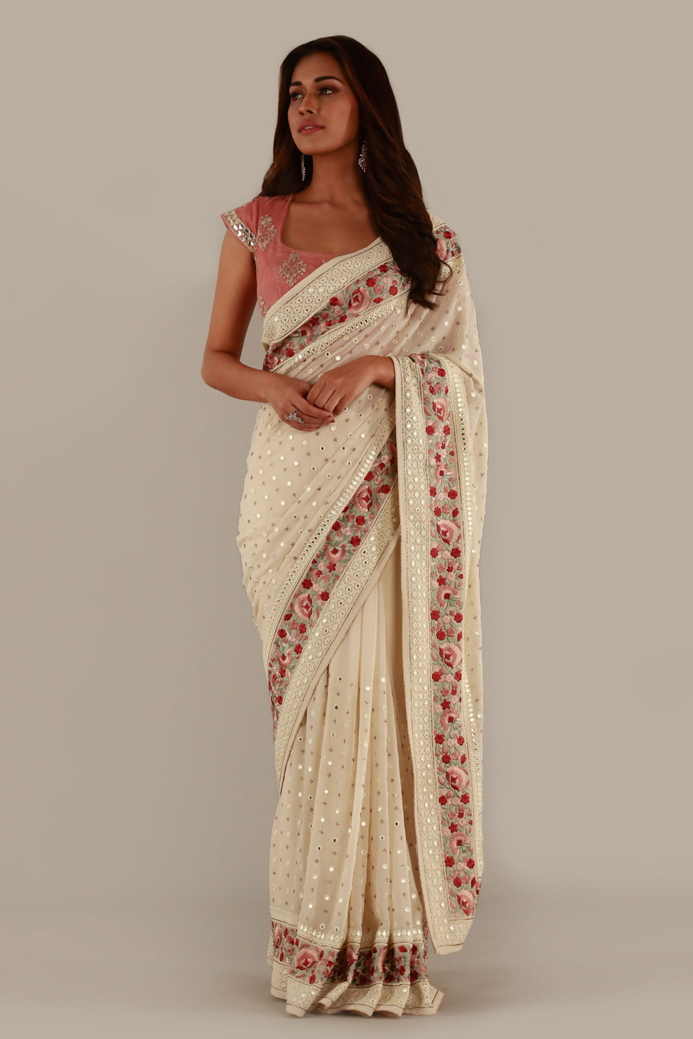 Ivory white classic saree with contrast border with thread work and contrast pink choli with embellishments