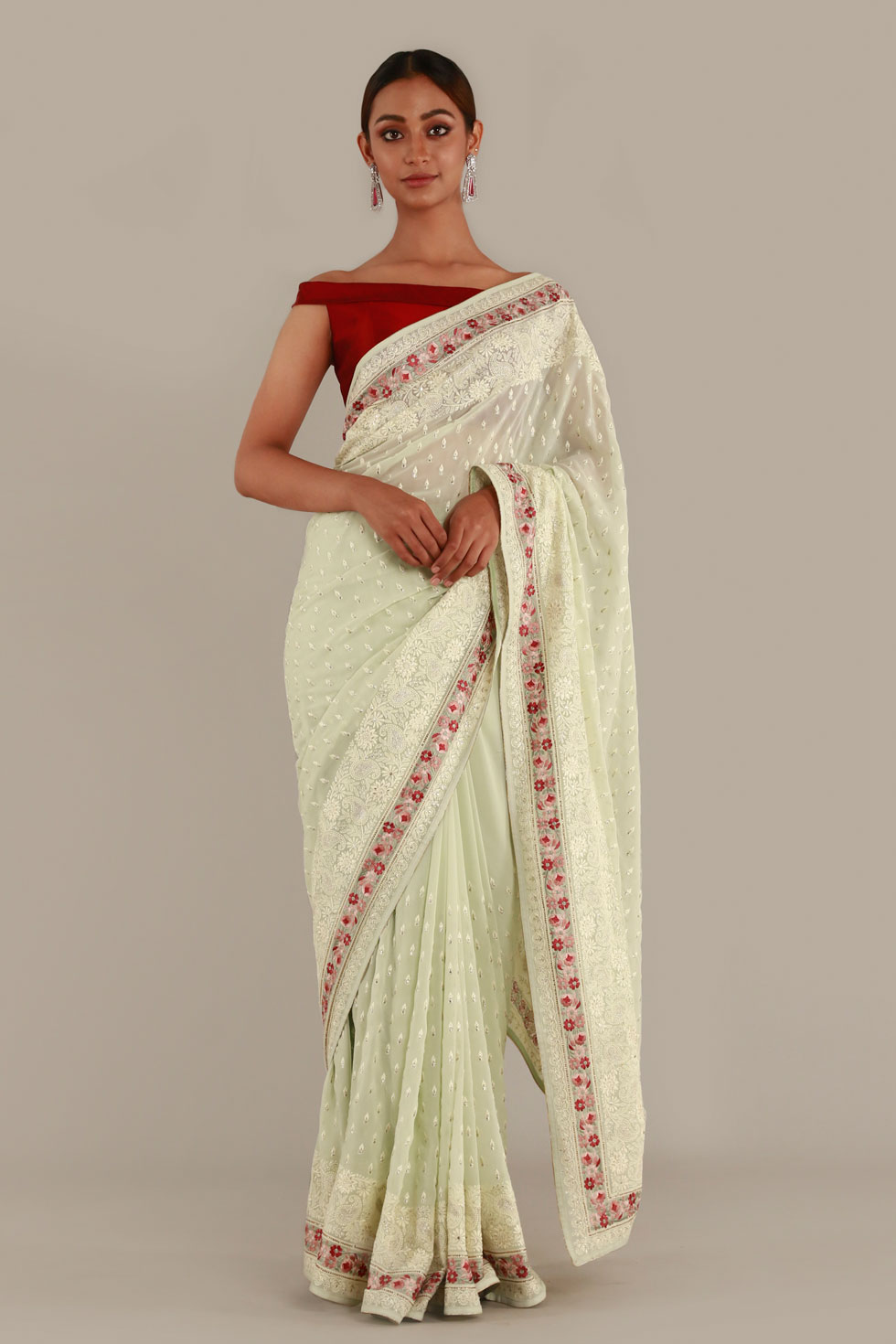 Pastel green classic saree with contrast off shoulder choli and contrast border with pearl embellishments