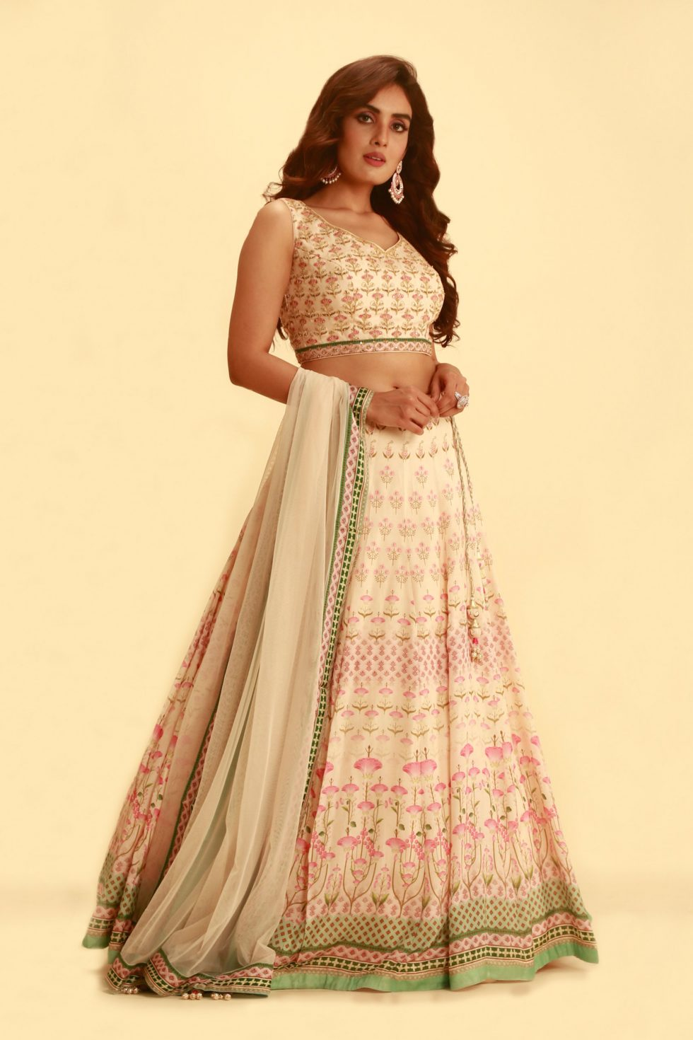 Baby pink printed lehenga set with contrast fern green colour and matching tulle dupatta