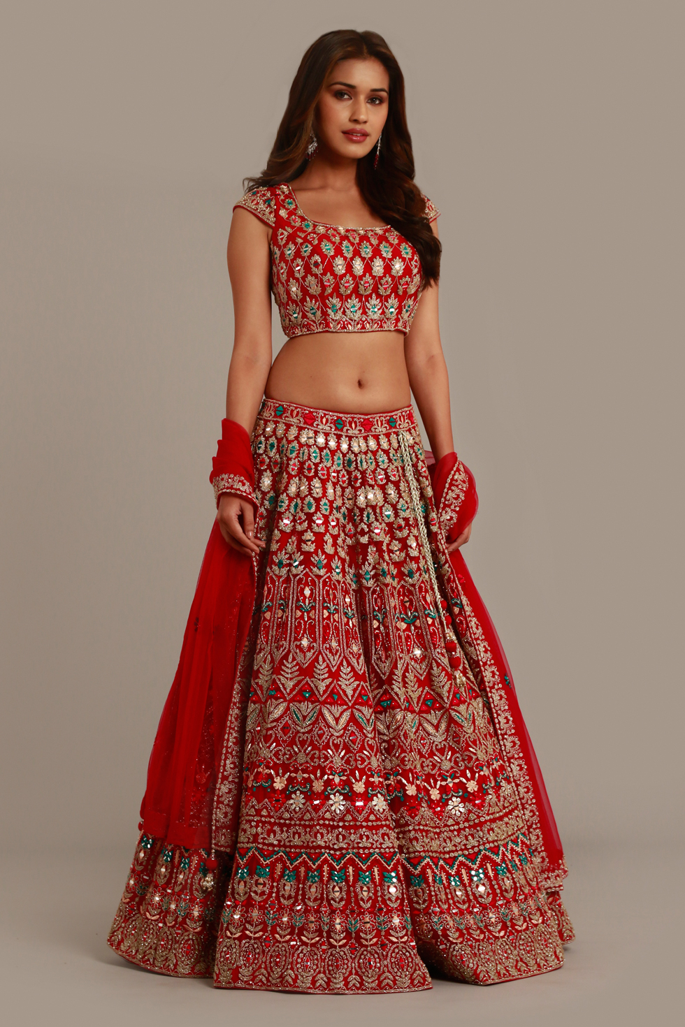 Fiery red  lehenga set with multi coloured embroidery, silver embellishments and matching dupatta