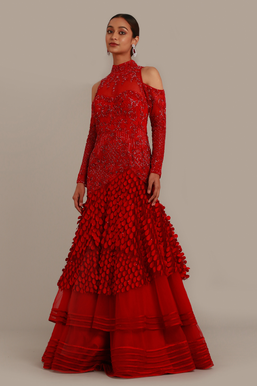 Fiery red gown with cold shoulder, matching embroidery and cut work petal detail