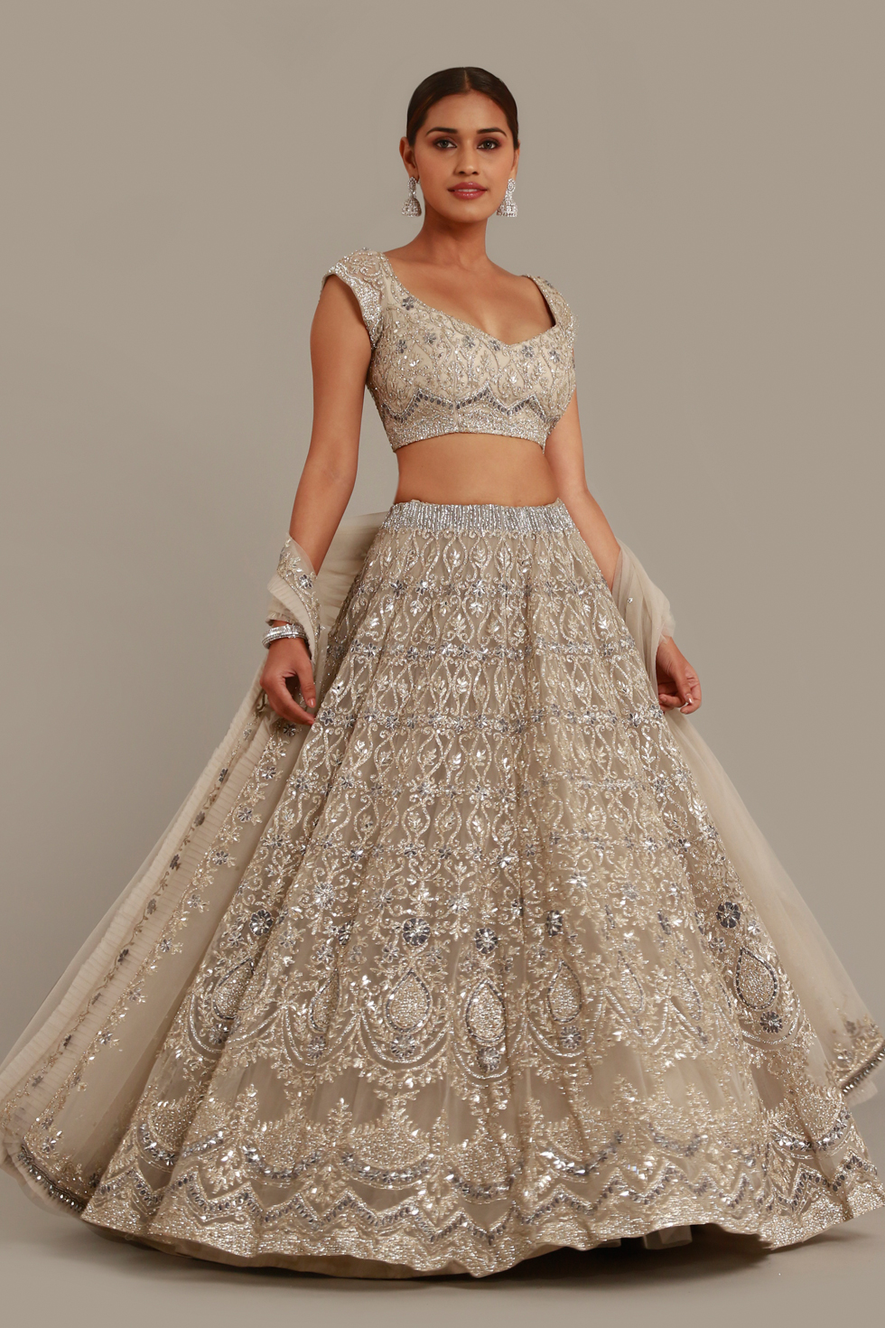 Steel grey lehenga set with silver grey embroidery and matching dupatta with frill details