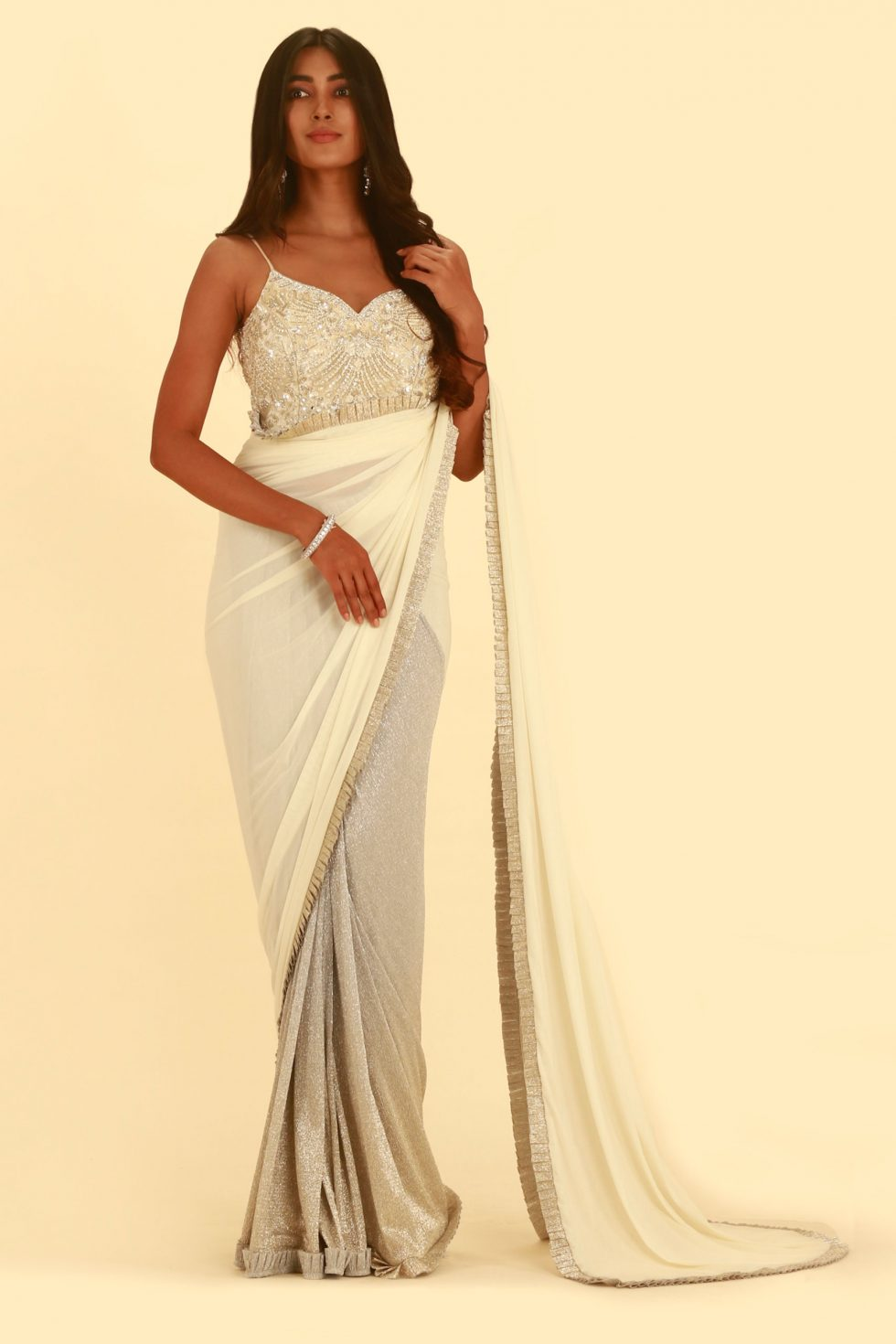 White saree with shimmery ice silver pleating and matching pallu with frill detail and matching embroidered blouse
