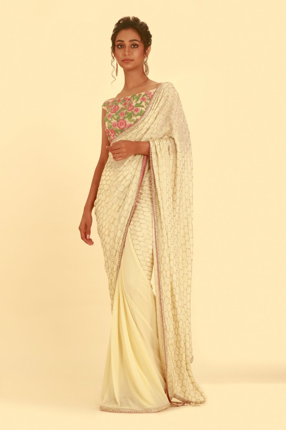 Cream beige saree with gold detail pallu and contrast multi coloured blouse