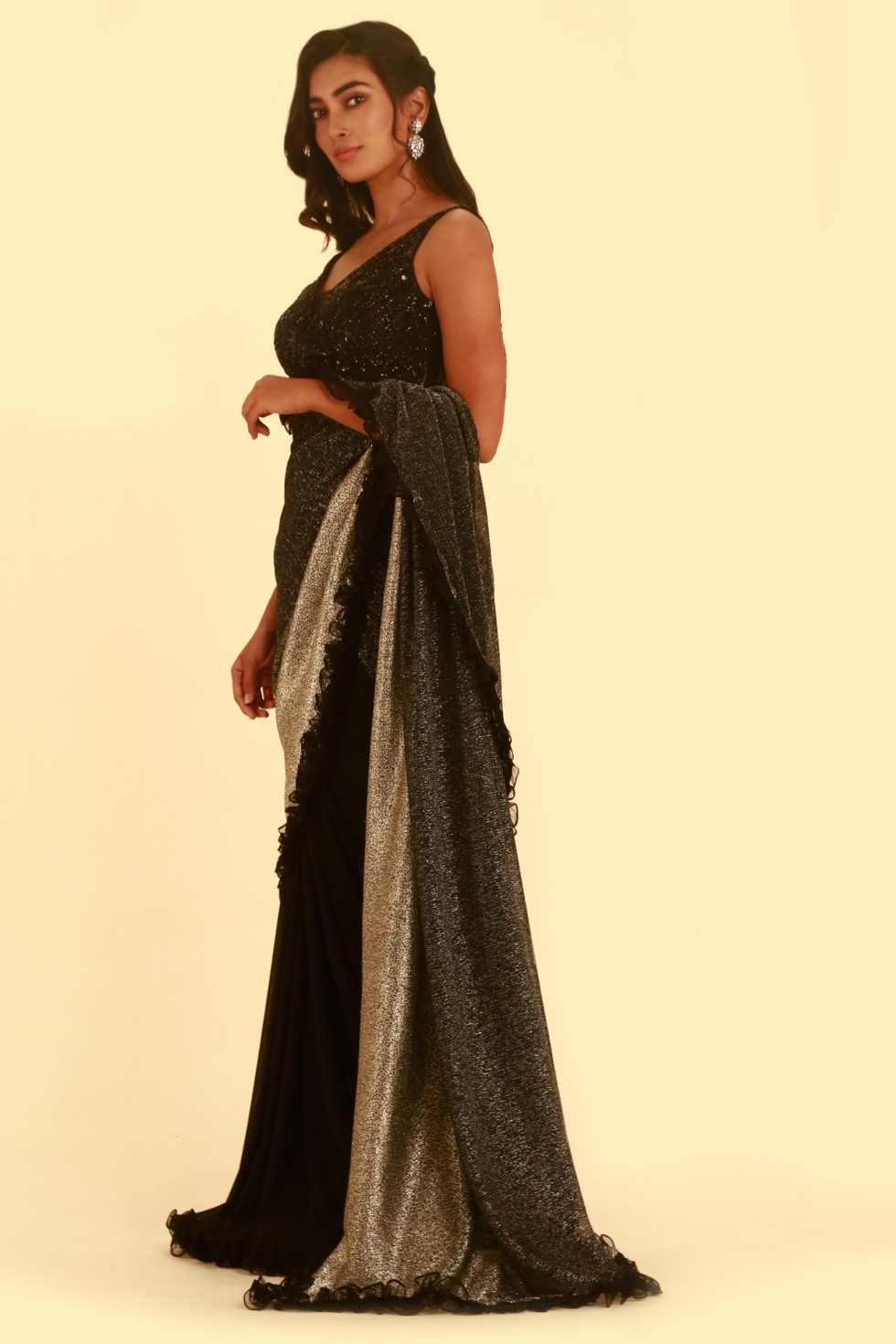 Jet black saree with black and silver shimmer pallu with frill detail and matching embroidered blouse