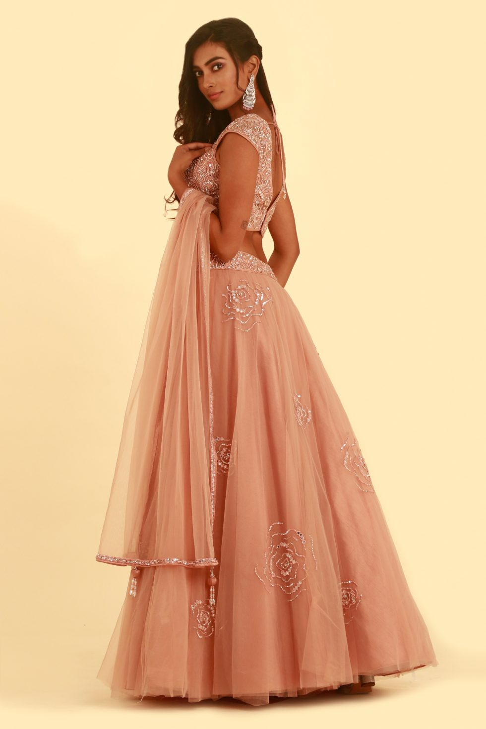 Rustic pink tulle lehenga set with matching dupatta and embroidered blouse