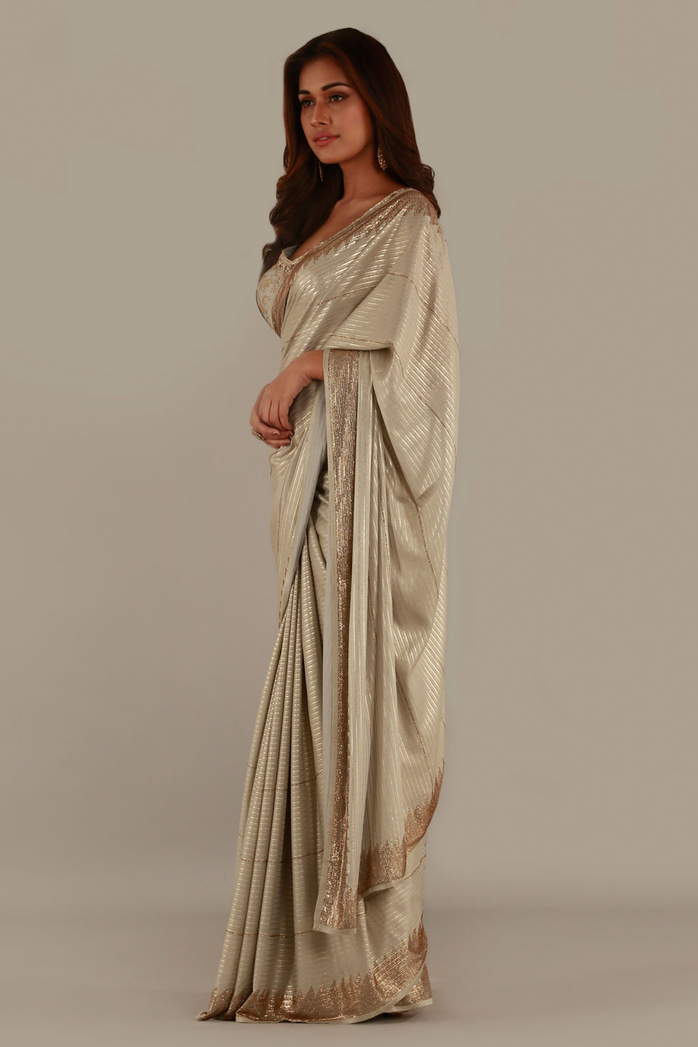 Beige gold classic saree with matching pallu and border and blouse with gold embellishments