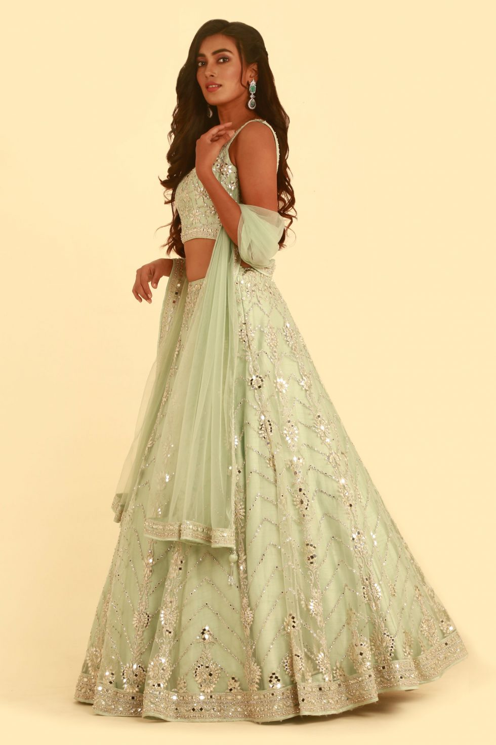Mint green lehenga set with 'abla' embroidery and matching blouse and dupatta