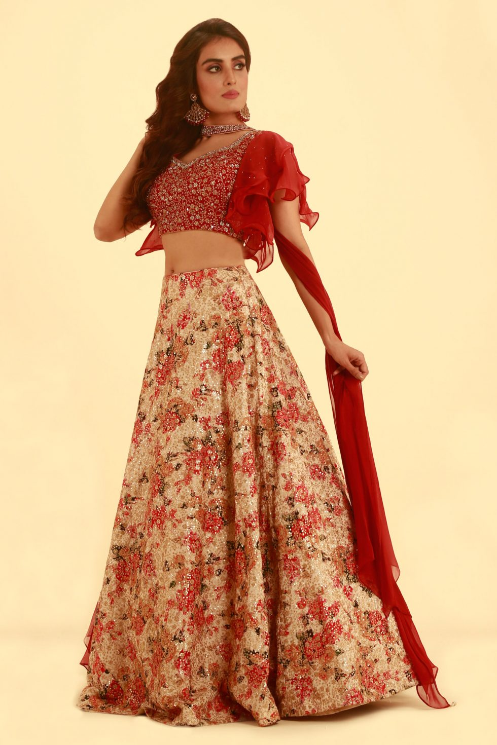 Fiery red sequin lehenga set with floral motifs, frill sleeves and a matching necklace dupatta