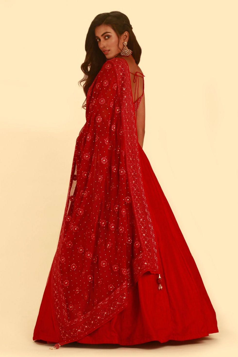 Scarlet red lehenga set with matching blouse and thread embroidered dupatta with gold embellishments