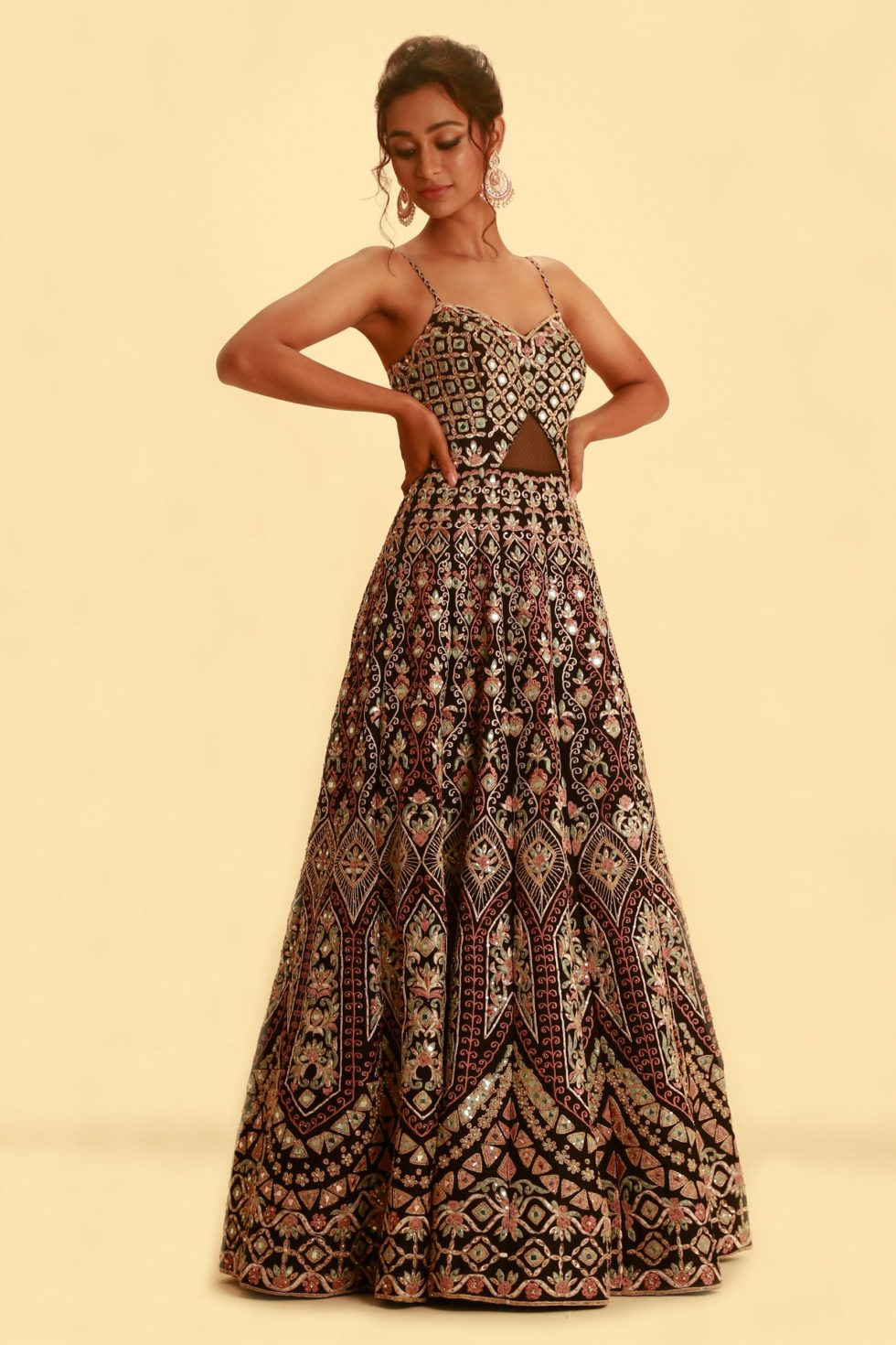 Jet black cut out gown with multi coloured embroidery and braided straps