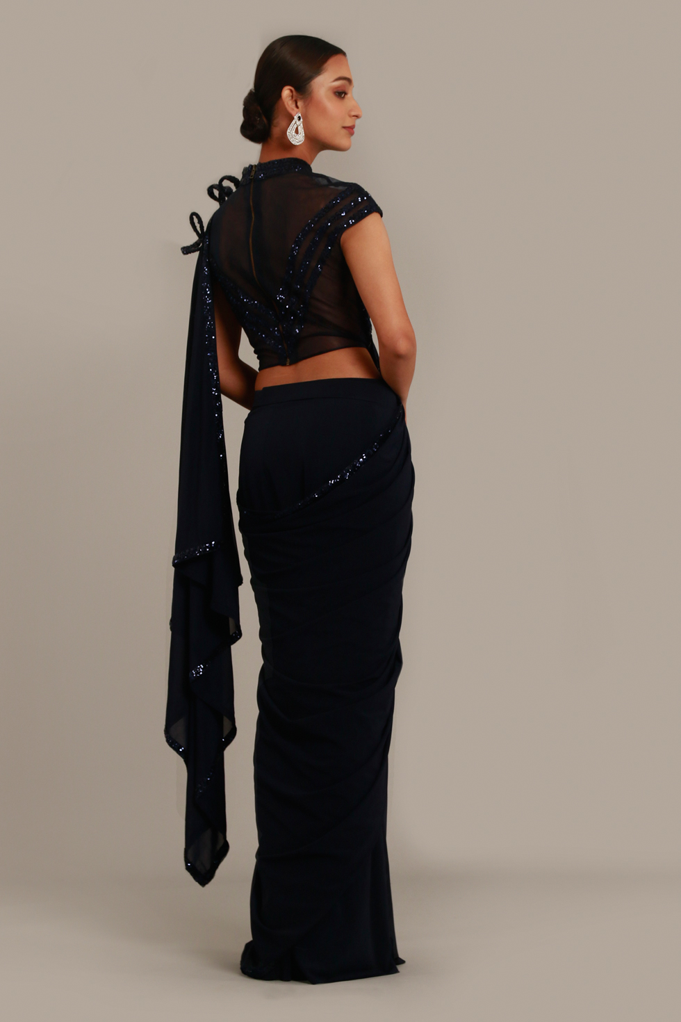 Midnight blue saree with 3-D detail on the shoulder, cutout blouse and shimmery details