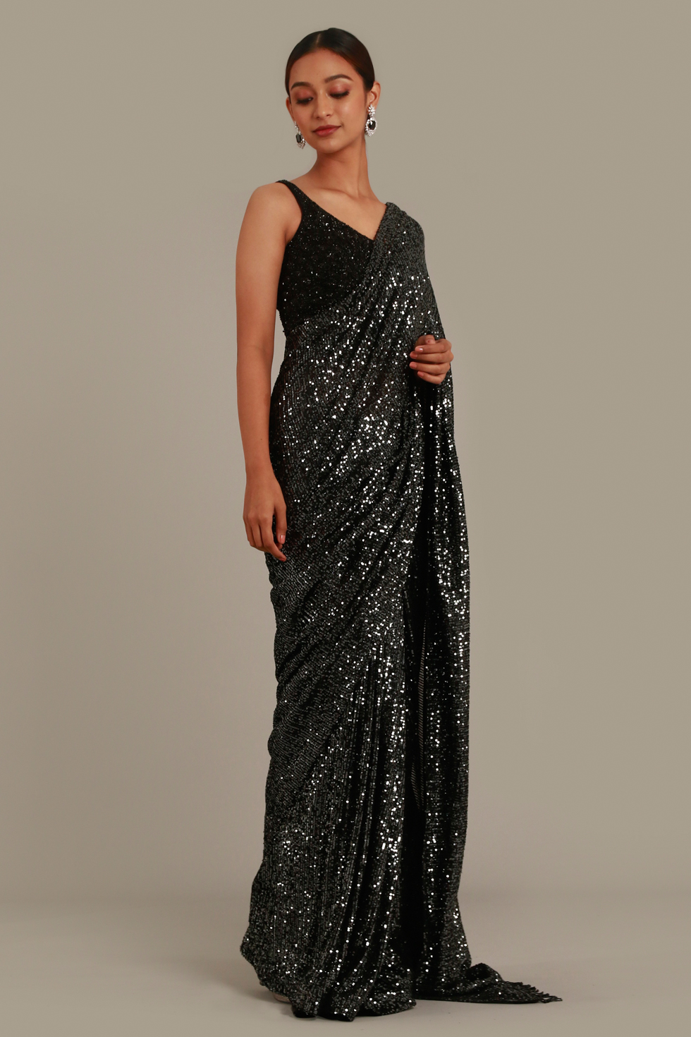 Ash black shimmer saree with matching pallu and black embroidered choli with tassels
