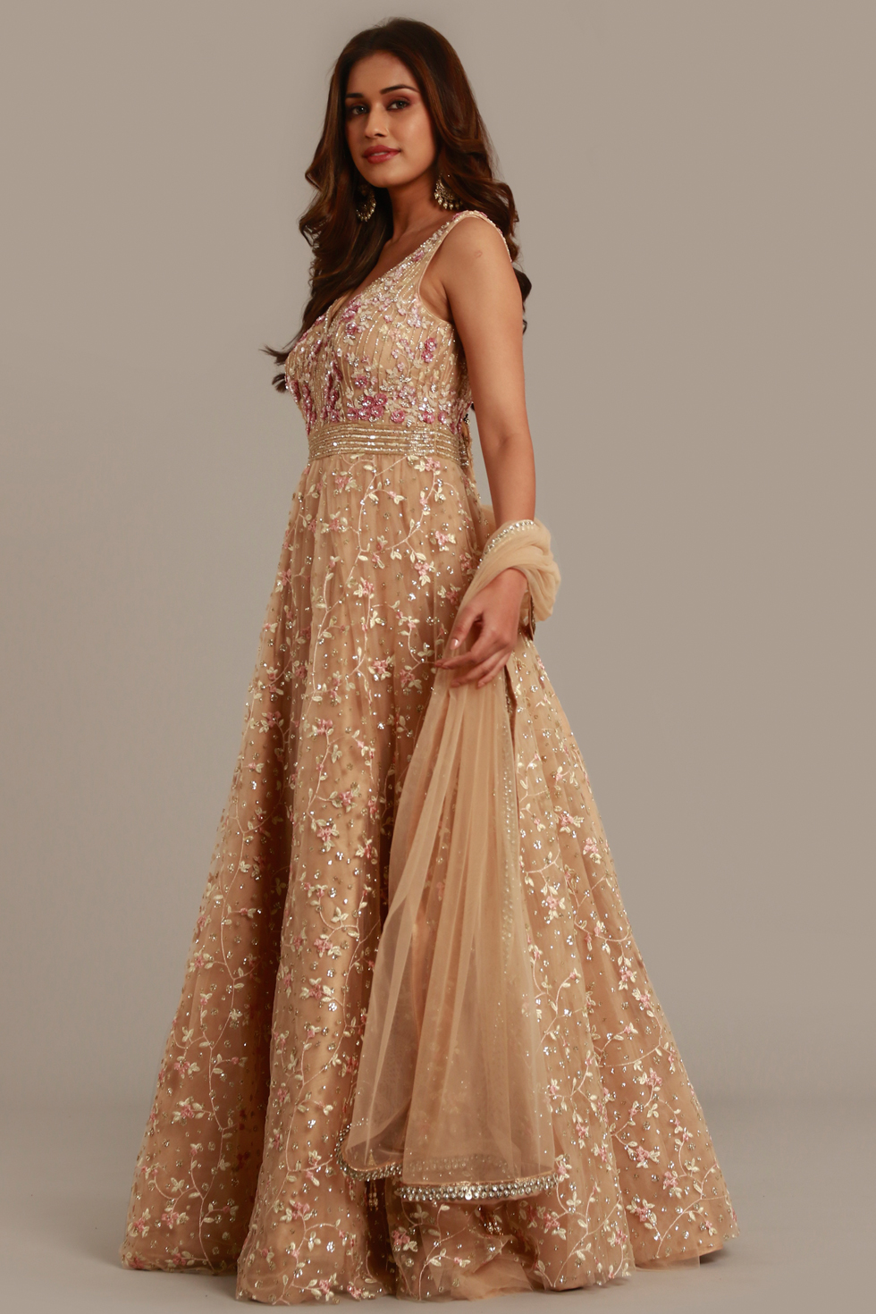Gold beige Anarkali gown set with contrast embroidery, matching dupatta and gold and silver embellishments