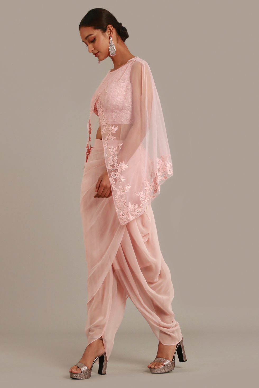 Blush pink draped dhoti set with matching embroidered crop top and cape