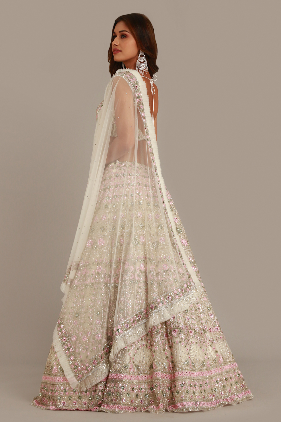 Ivory white lehenga set with contrast multi coloured embroidery and matching frill dupatta with silver embellishments