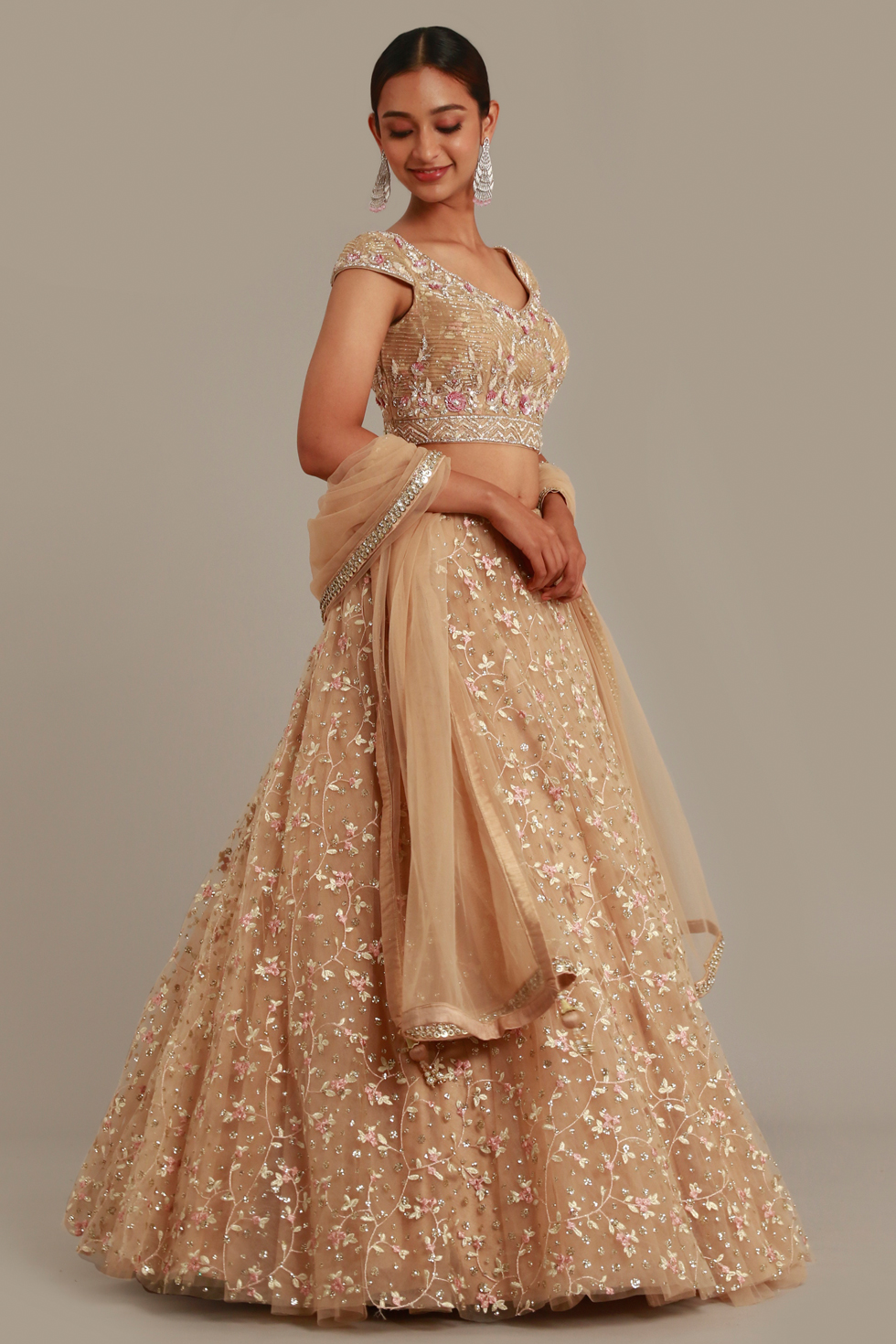Beige gold lehenga set with contrast embroidery and matching dupatta