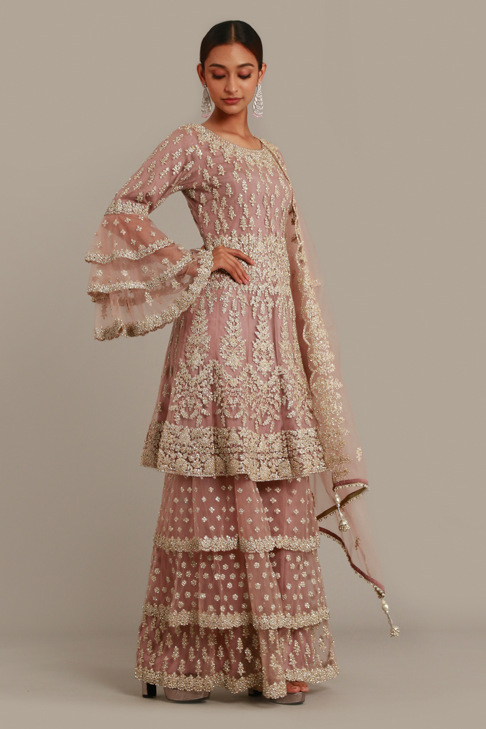 Pale ice pink layered sharara set with silver embroidery, tiered sleeves and matching scalloped dupatta