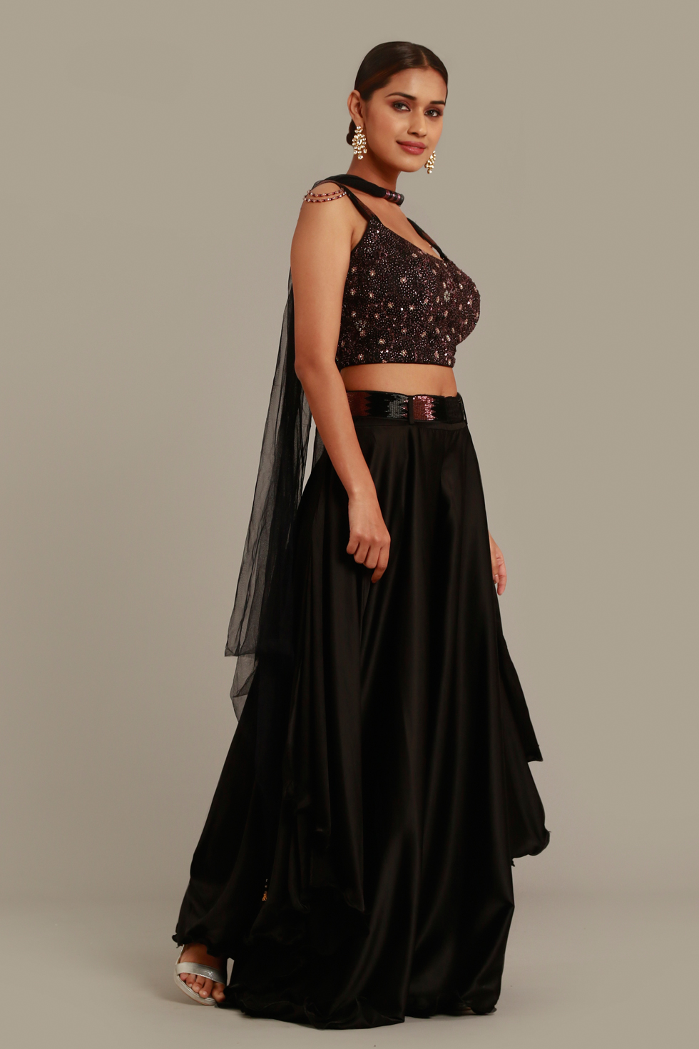 Solid black draped palazzo pant set with matching embroidered top, belt, tassels and necklace dupatta