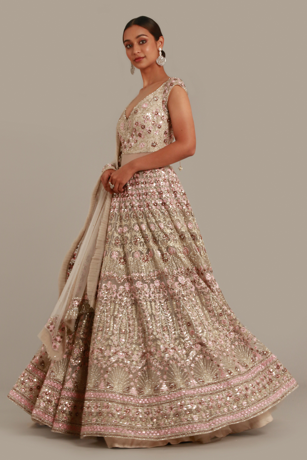 Grey gold Anarkali gown set with contrast multi coloured embroidery, silver highlights and matching dupatta with frill detail