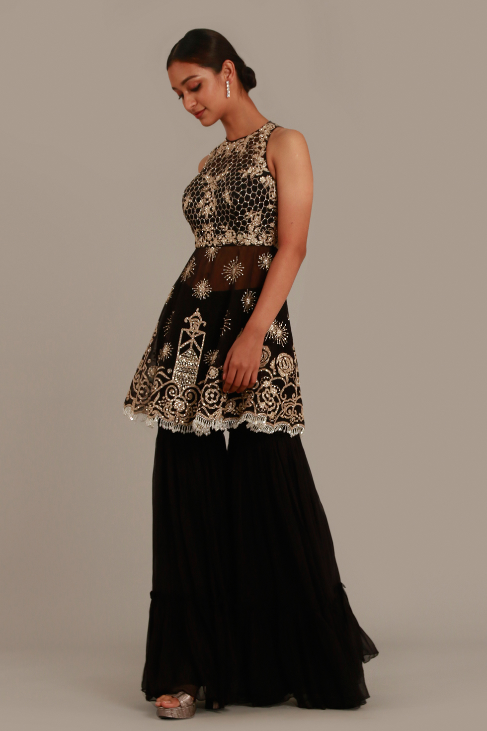 Raven black sharara set with incut peplum top and silver embellishments