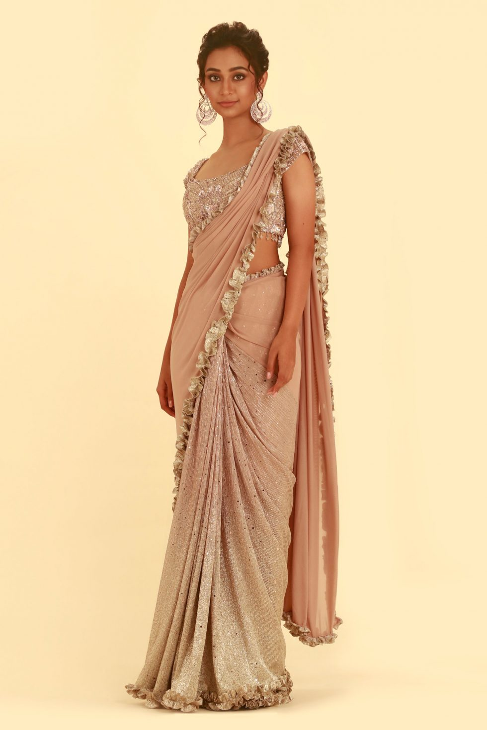 Rose pink saree with shimmery silver pink pleating and matching pallu with frill detail and matching embroidered blouse