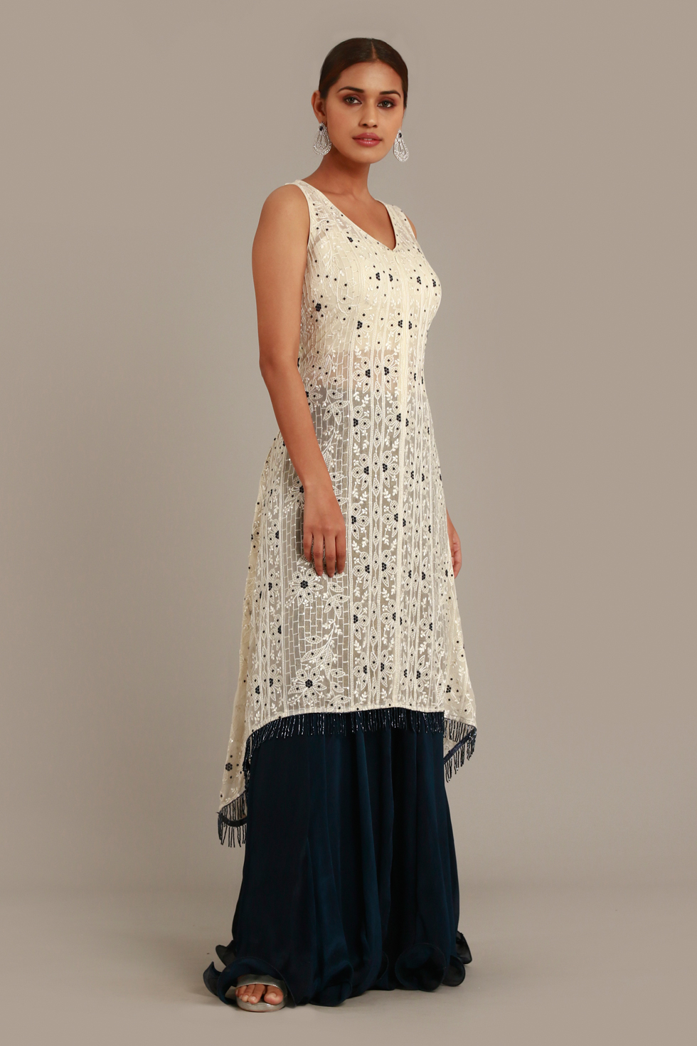 Ivory white long high-low hem top with thread embroidery and  midnight blue palazzo pants