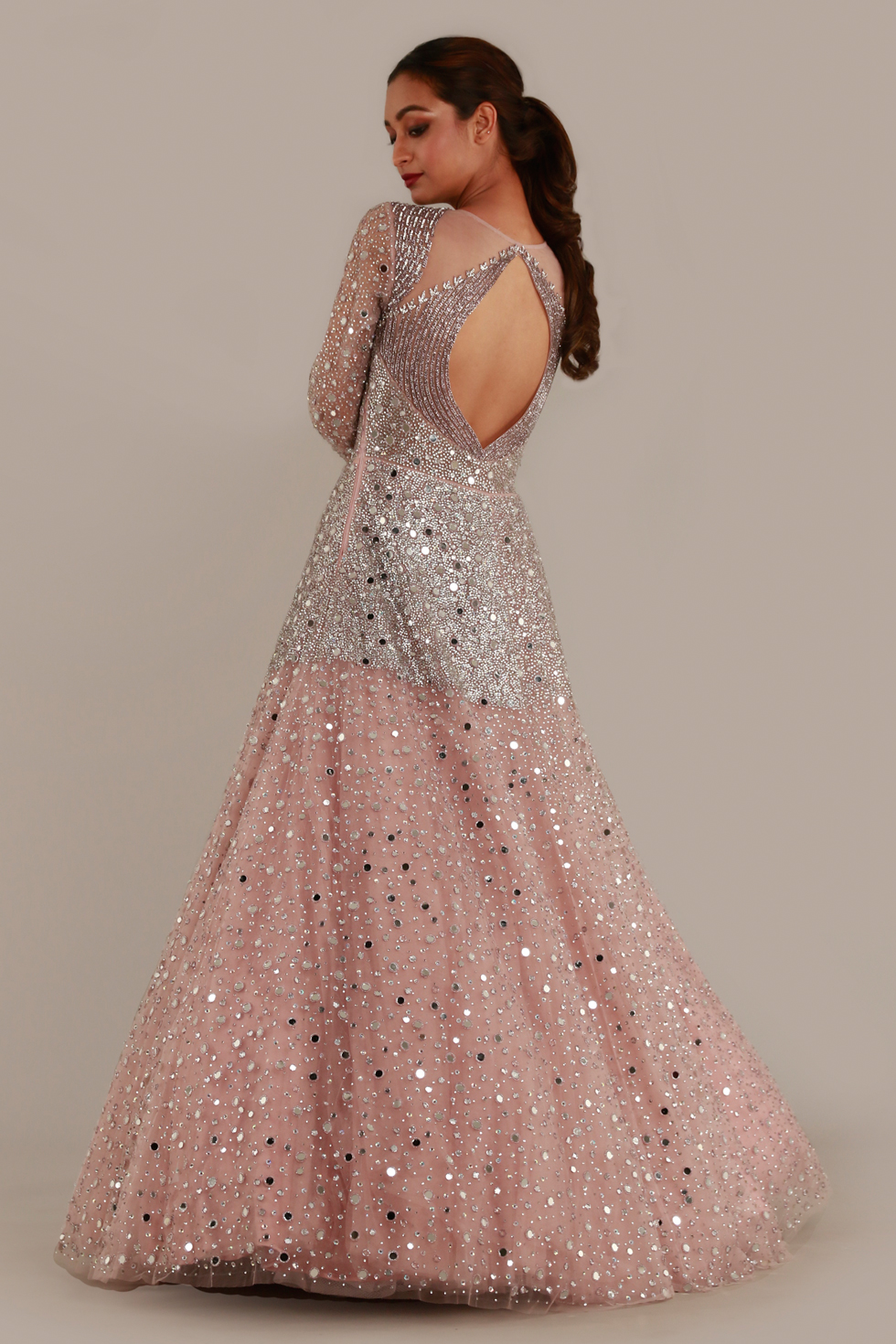 Baby pink shimmery tulle gown with illusion neckline and silver stone and mirror embellishments