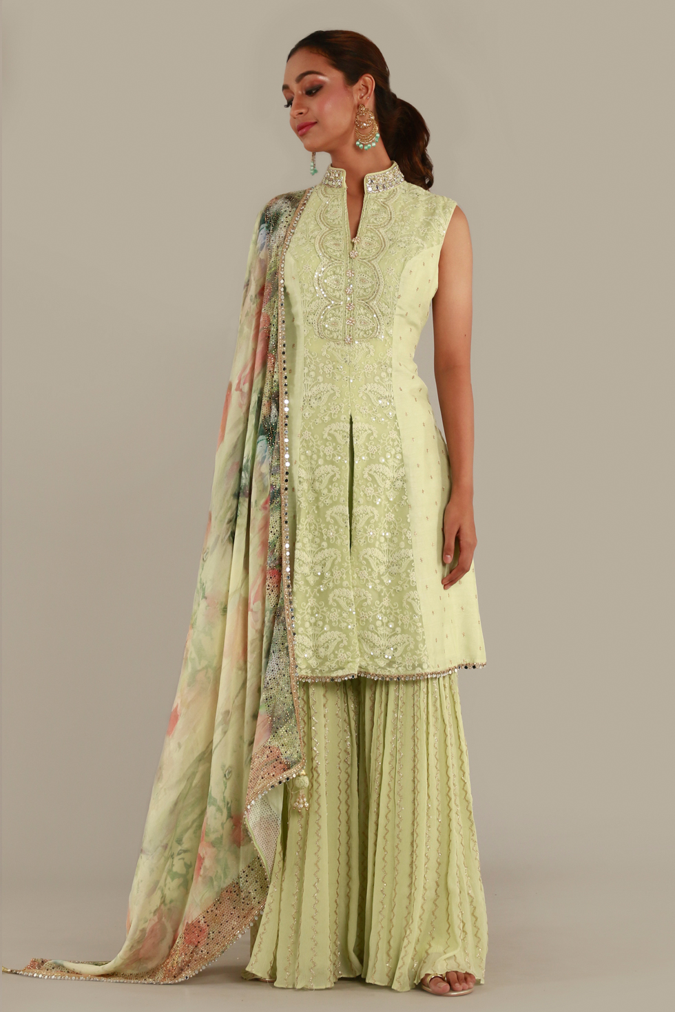 """Pastel green palazzo set with """"abla"""", thread work and gold details and printed dupatta with floral motifs"""