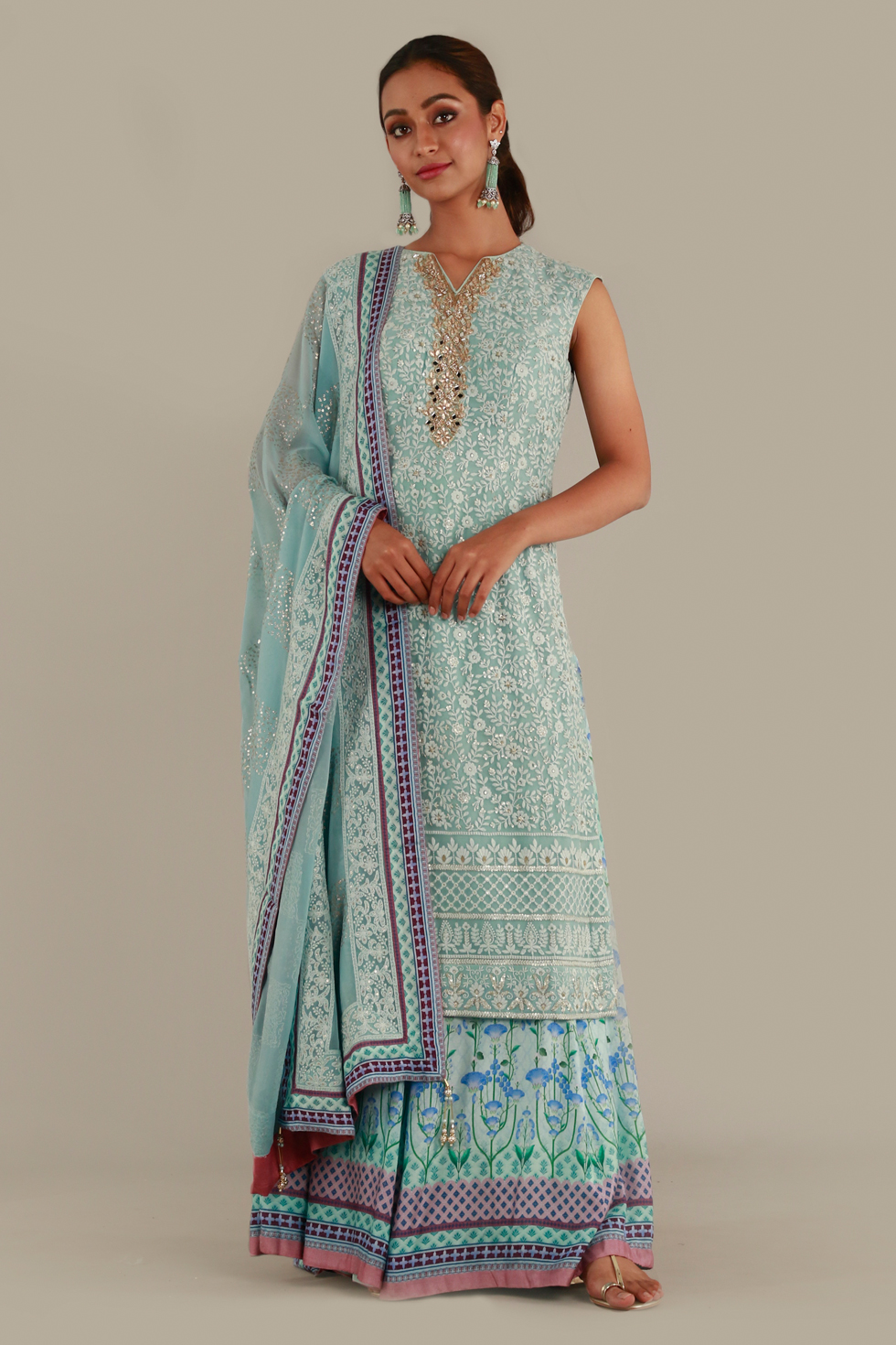 Blue kurta top with embroidered neckline, printed palazzo pants and matching dupatta with thread work and sequin details