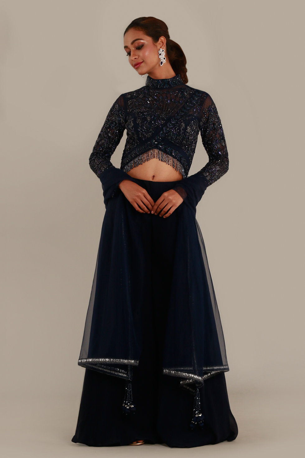 Navy blue palazzo set with hand embroidered crop top, matching dupatta and tassel details