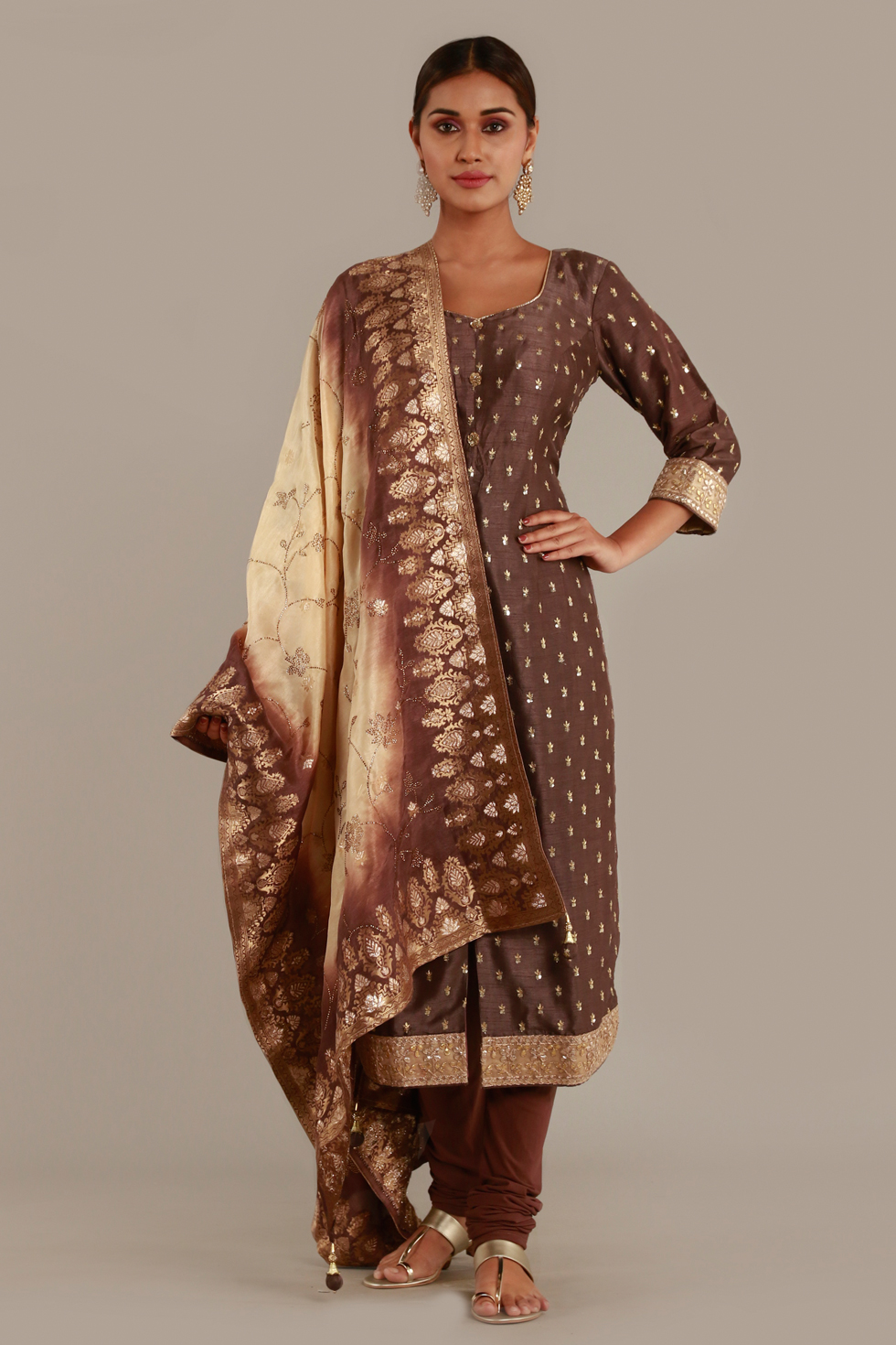 Deep brown kurta and churidar set with gold butis and two tone dupatta with gold details