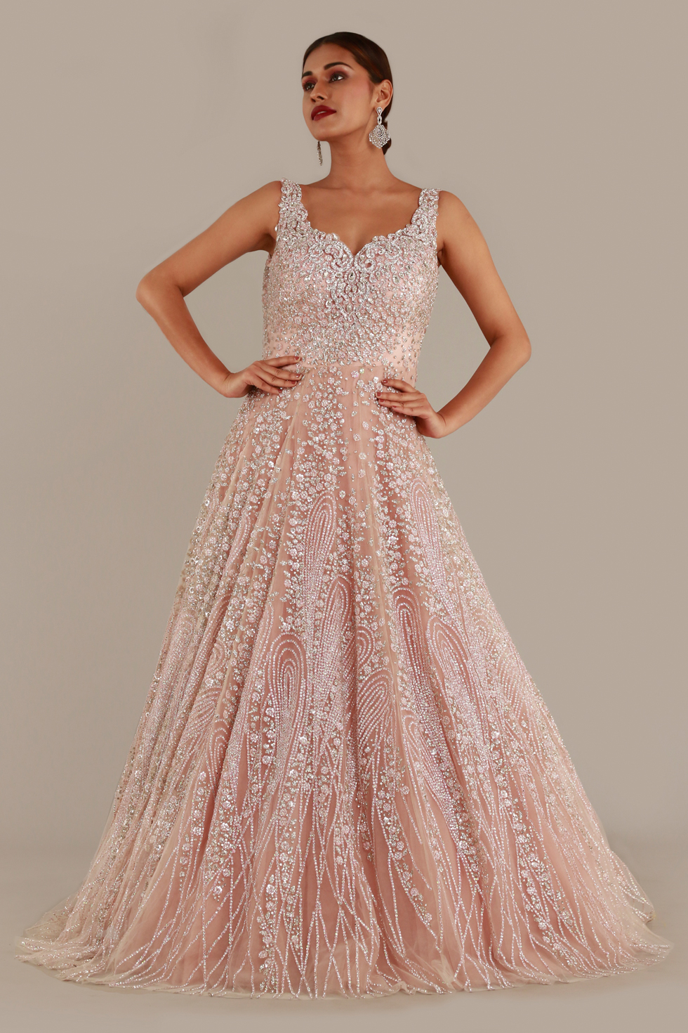 Blush  pink shimmery tulle gown with cut work neckline, silver embroidery and stone embellishments
