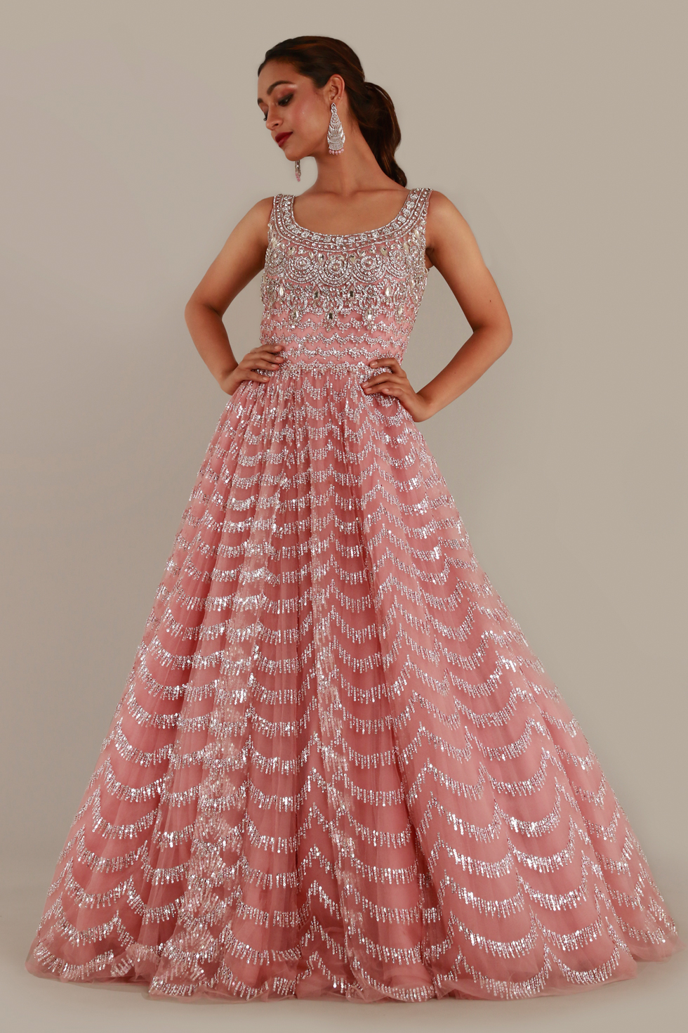 Taffy pink tulle gown with silver embroidery and stone embellishments