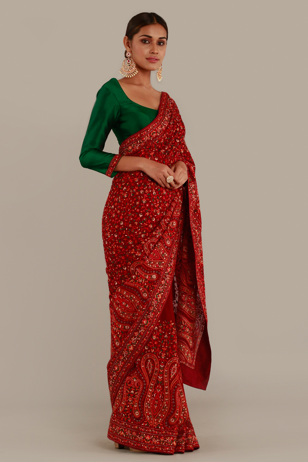 Deep red classic saree with multi coloured thread work and contrast forest green choli